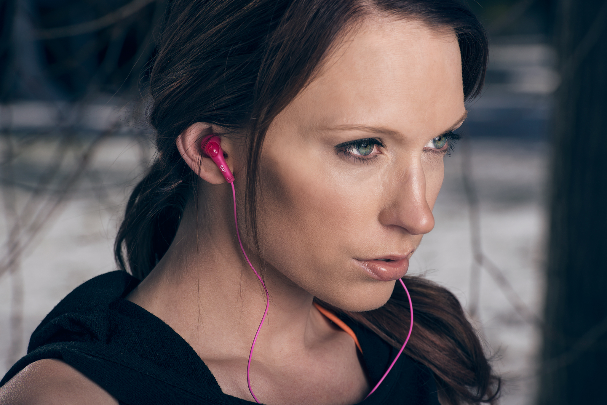 Active lifestyle and commercial portrait of female fitness model with JVC headphones