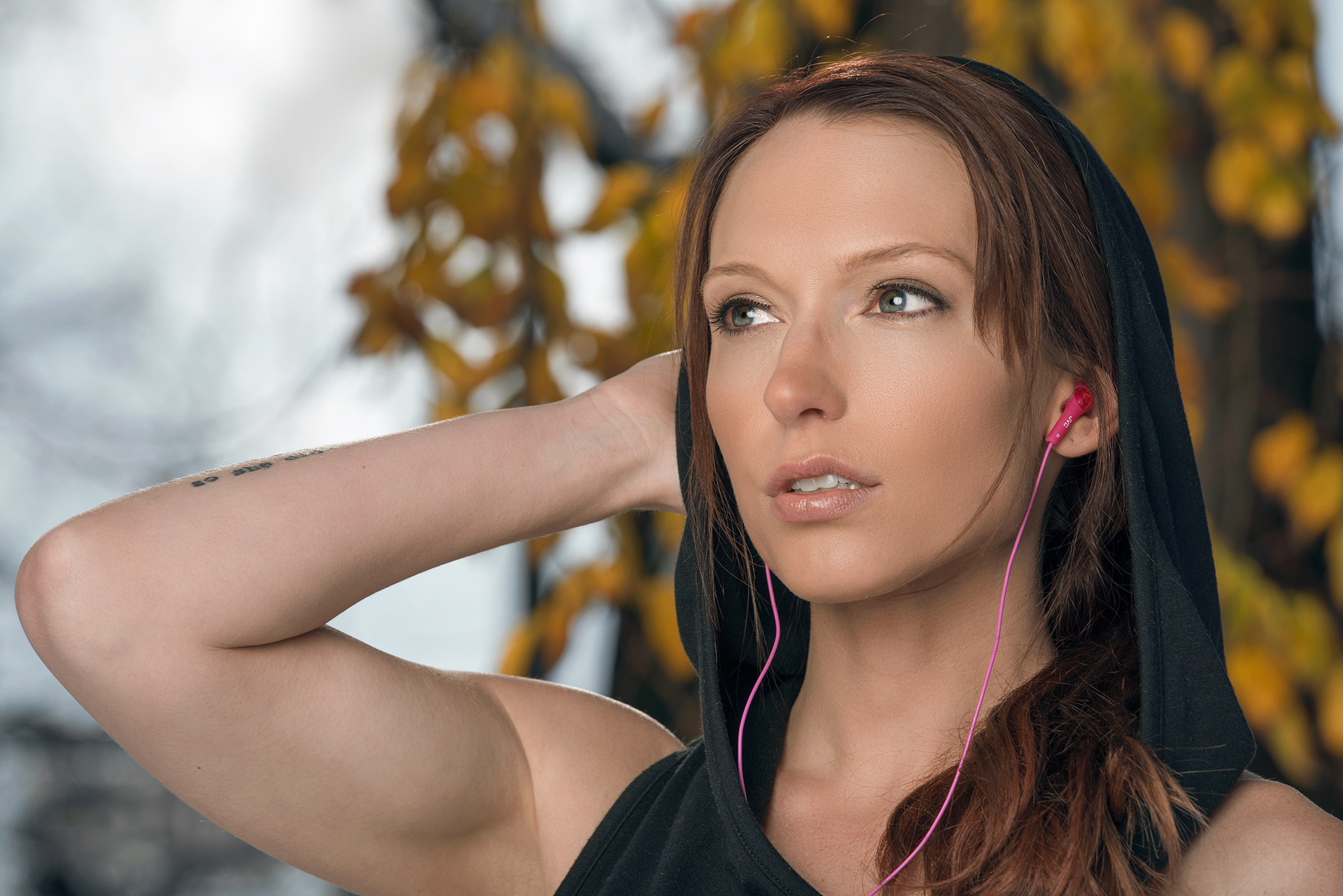 Portrait of female fitness model with JVC headphones