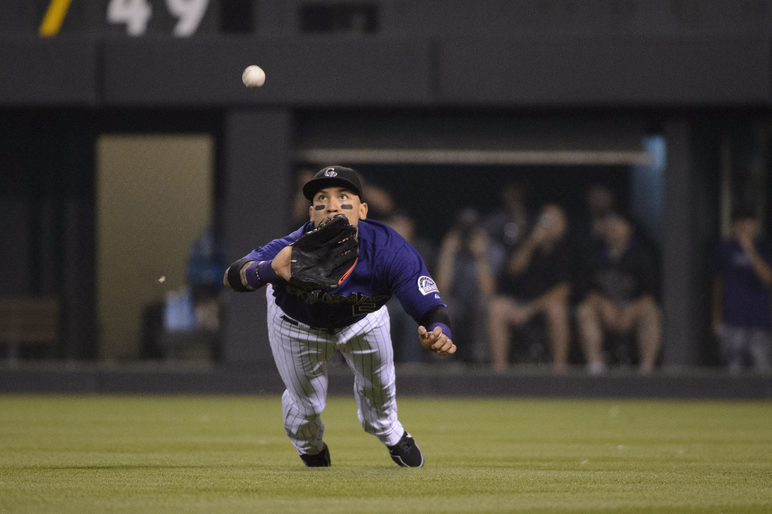 Rockies' outfielder Carlos Gonzalez makes a diving catch