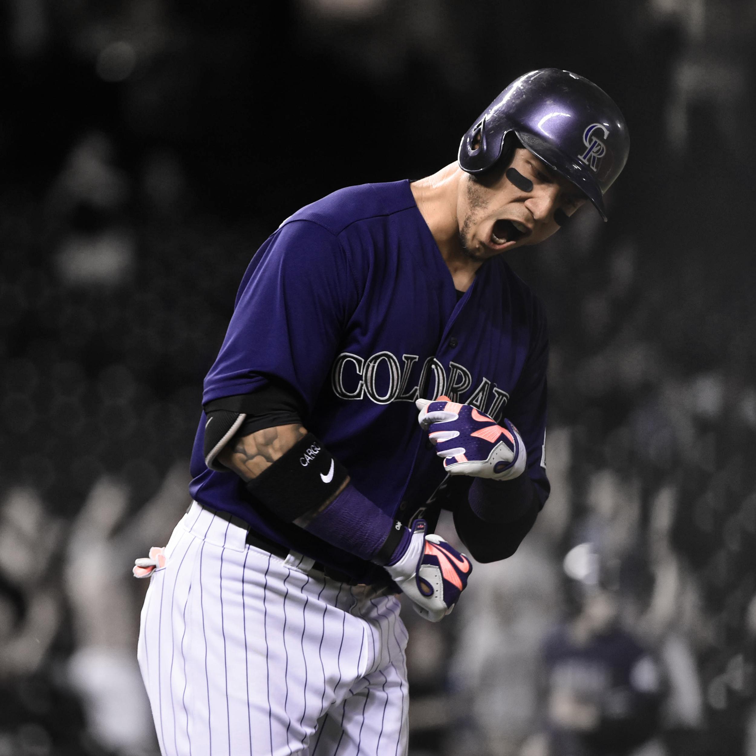 Rockies' outfielder Carlos Gonzalez celebrates after hitting a clutch grand-slam homerun