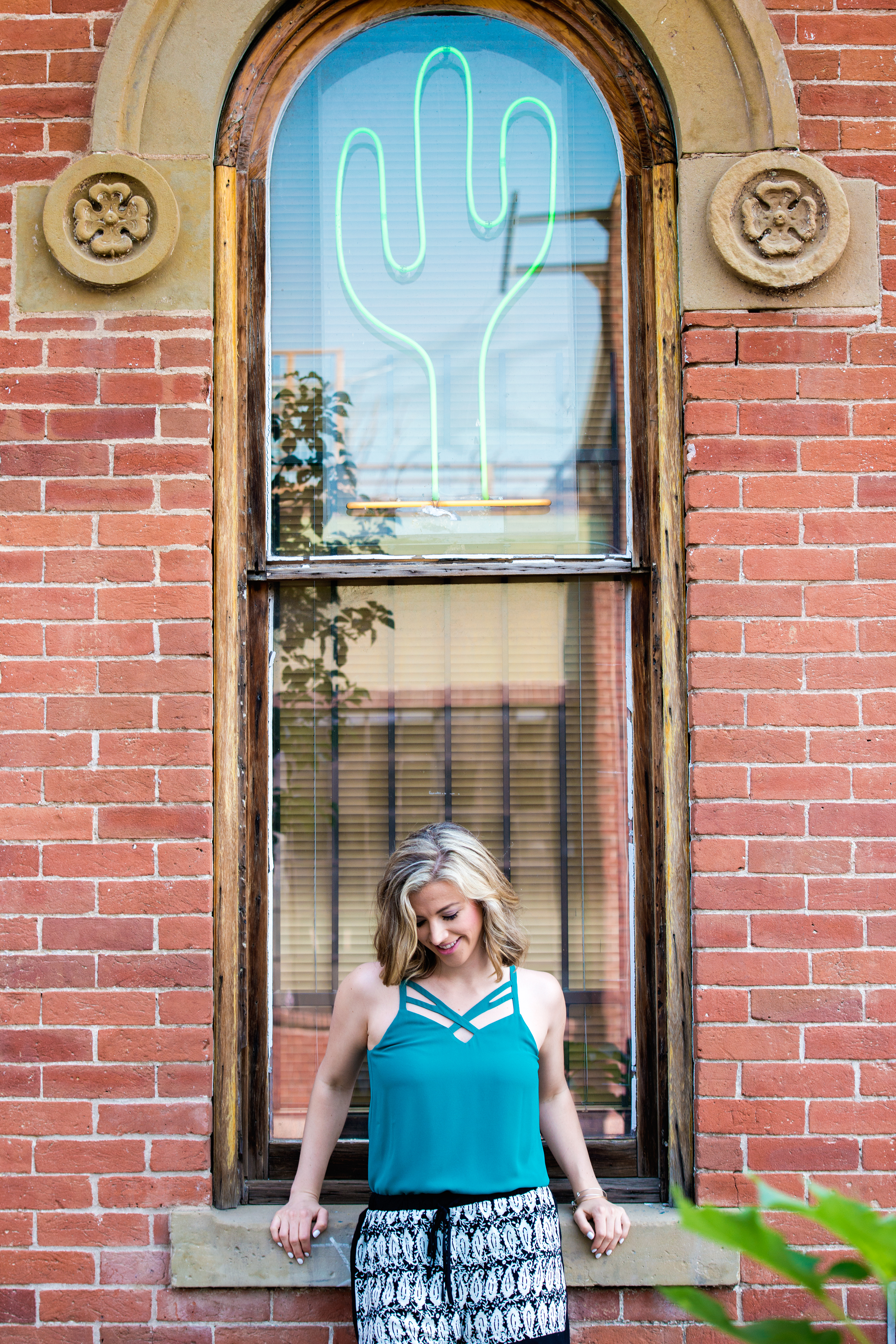 An advertising fashion lifestyle image with a neon cactus in Denver, CO