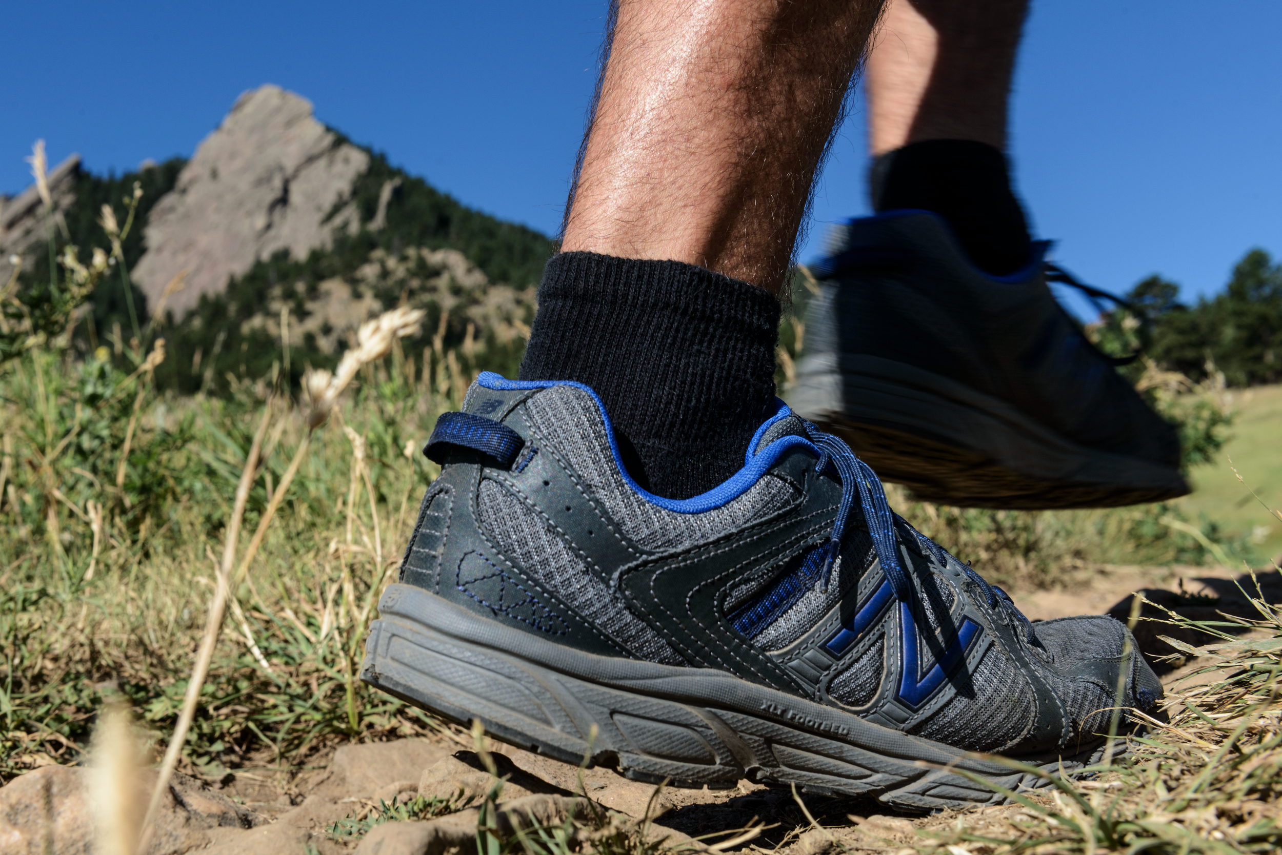 Lifestyle product shot of New Balance Trail running shoes