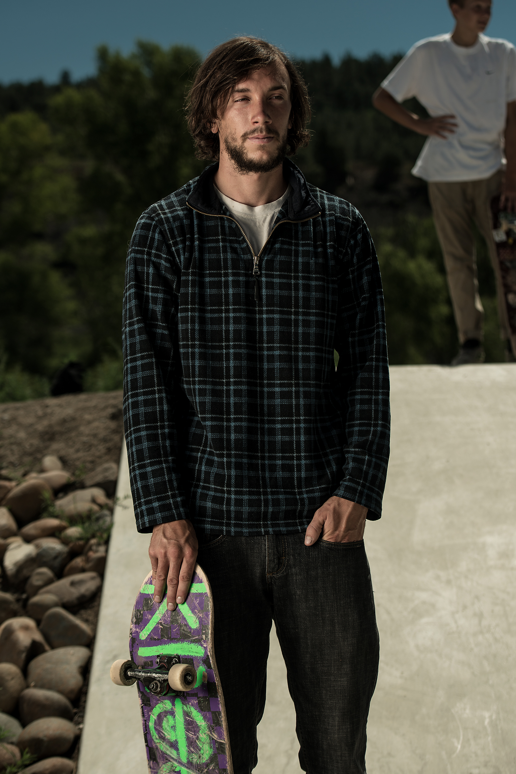 A skateboarder pauses during a small competition for a portrait