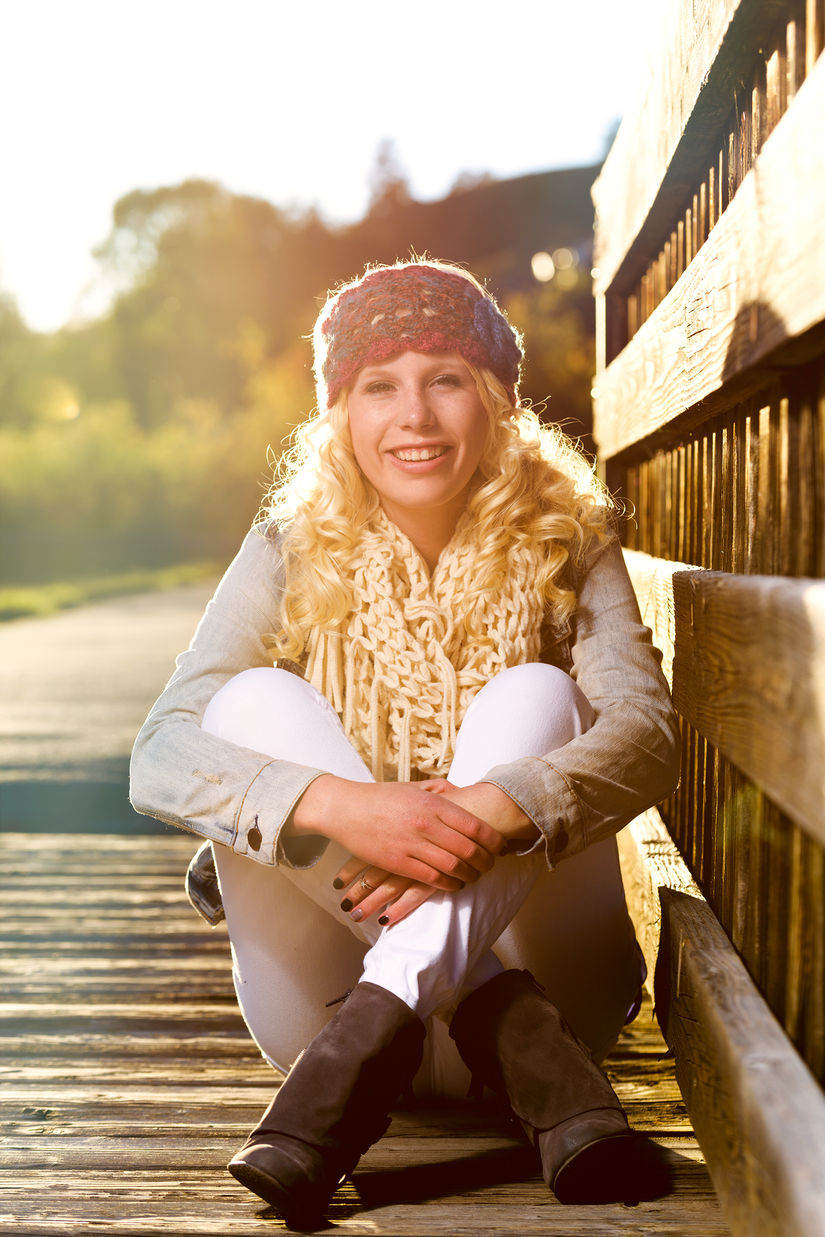 Fashion lifestyle photo with a teenage girl in a handmade headband and scarf during sunset