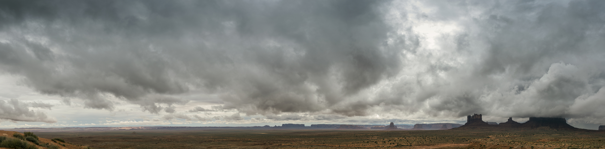 A panorama of Monument Valley shot from Utah looking into Arizona.