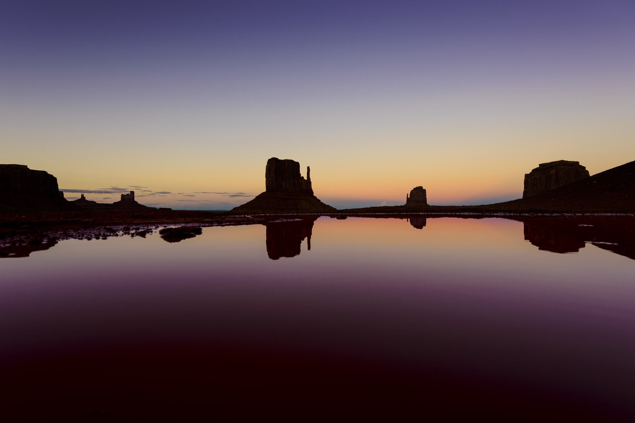 Monument Valley dusk and sunset with reflection