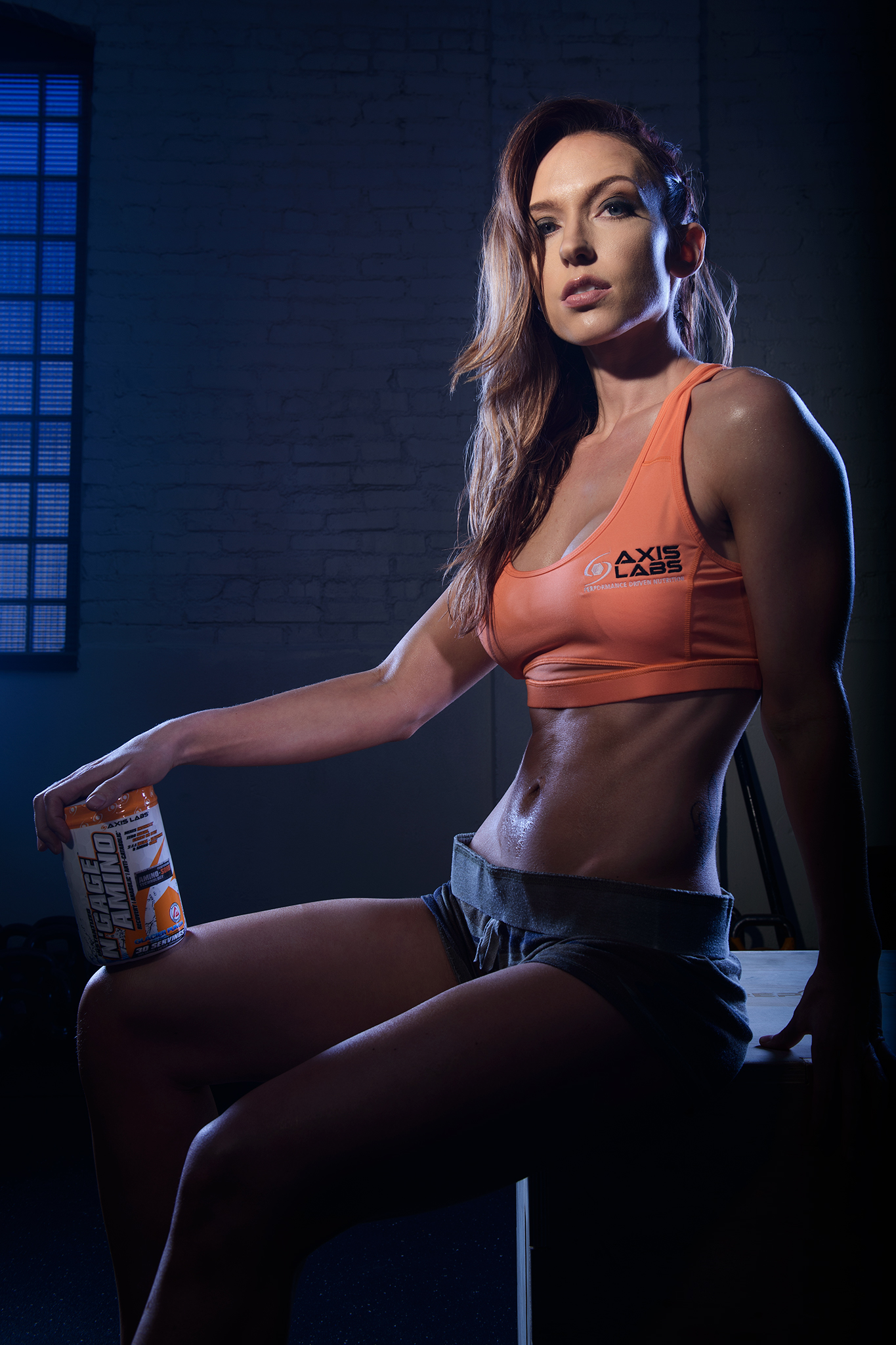 Advertising image for Axis Labs N-Gage Amino with a fitness model rep