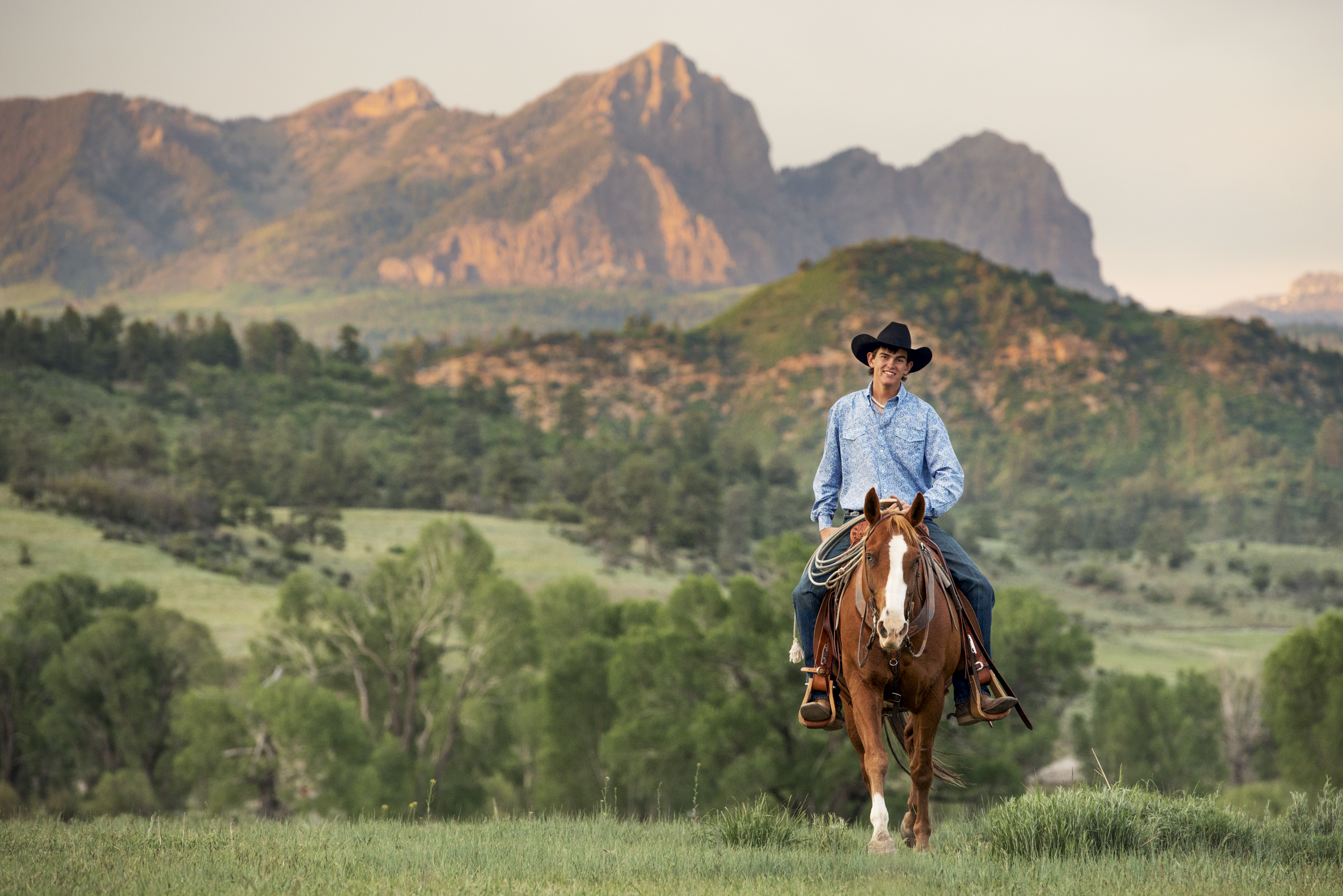 Male horseback rider at sunset near the Colorado/New Mexico state line