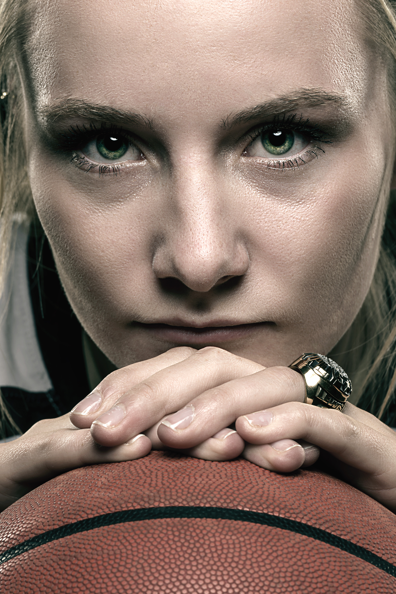 Female basketball player portrait with championship ring
