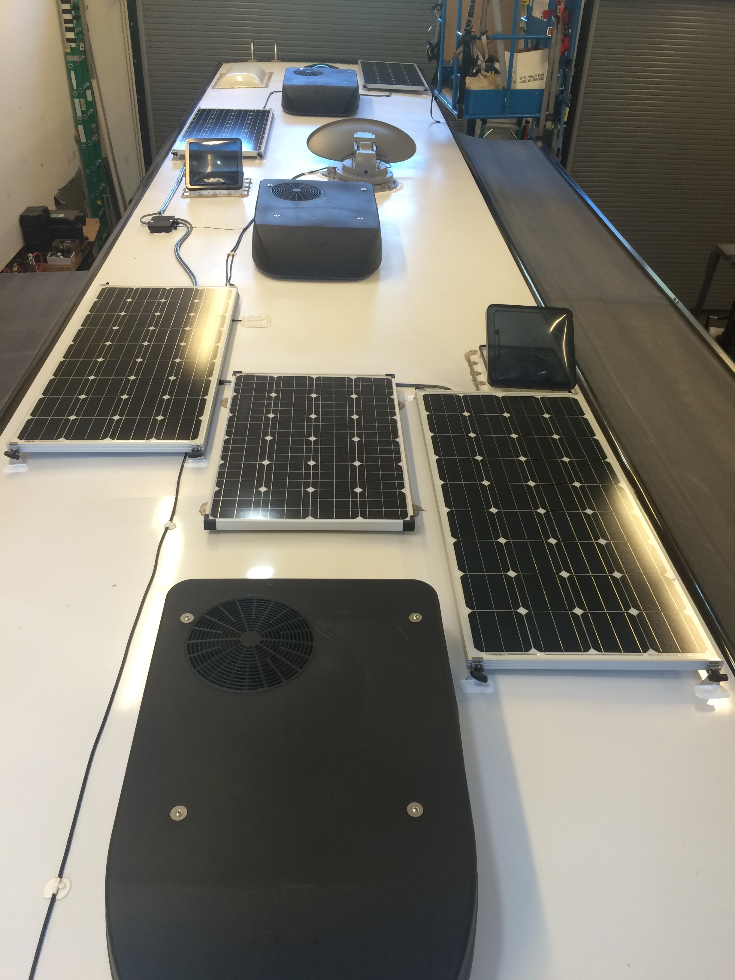 Four AM Solar Panels and one factory panel