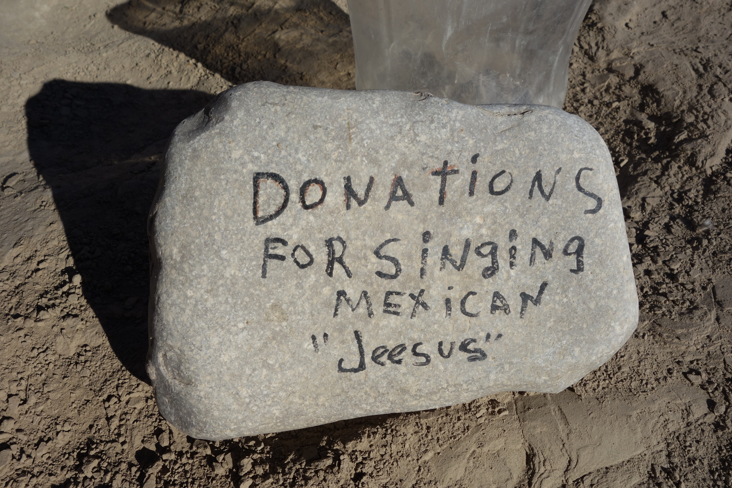 as seen on the US mexico border. he comes out and sings across the border river.