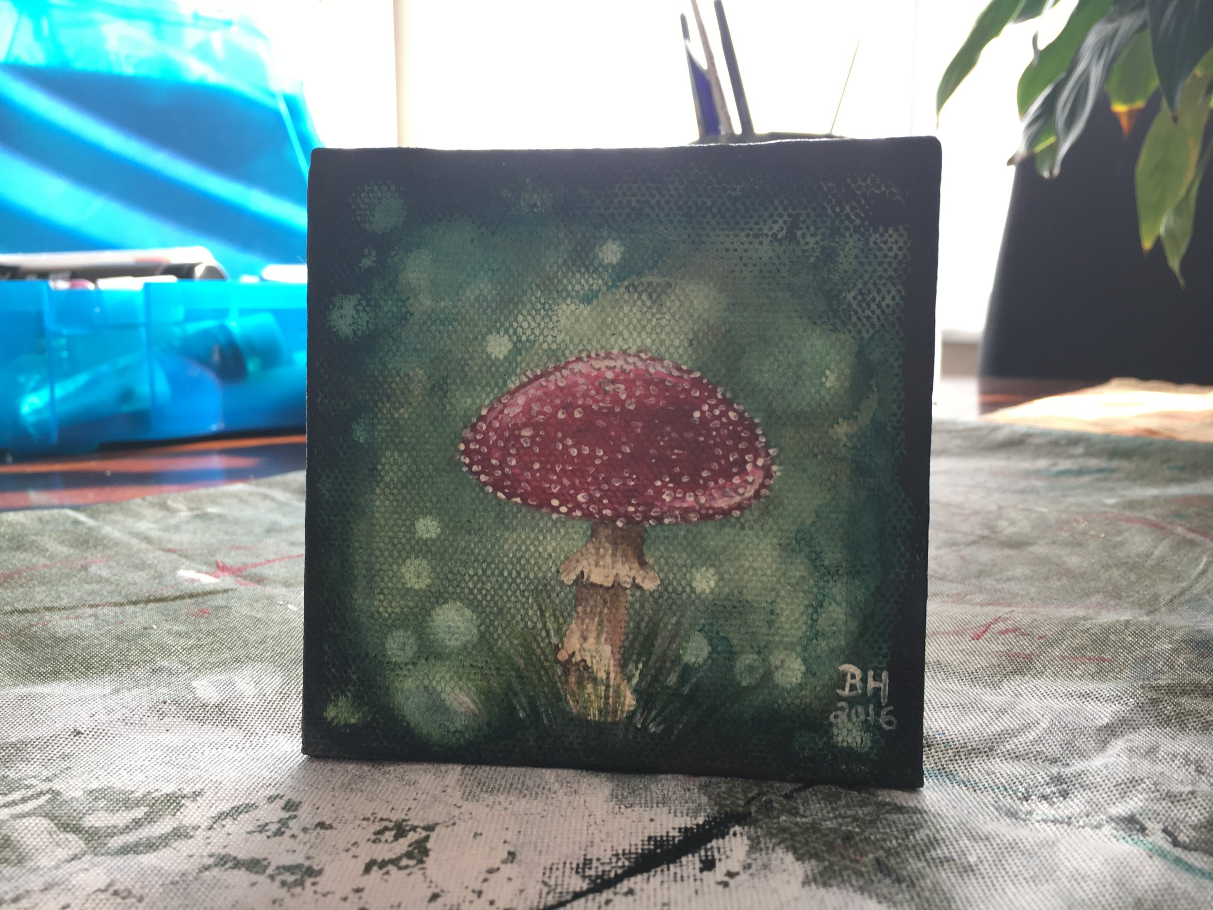 I recently replaced the stylized alligator I had painted on this mini canvas with a fun little mushroom, and I'm very happy I went back and reworked that painting that I didn't like instead of throwing the canvas in the garbage! (I throw away A LOT of failed attempts.)