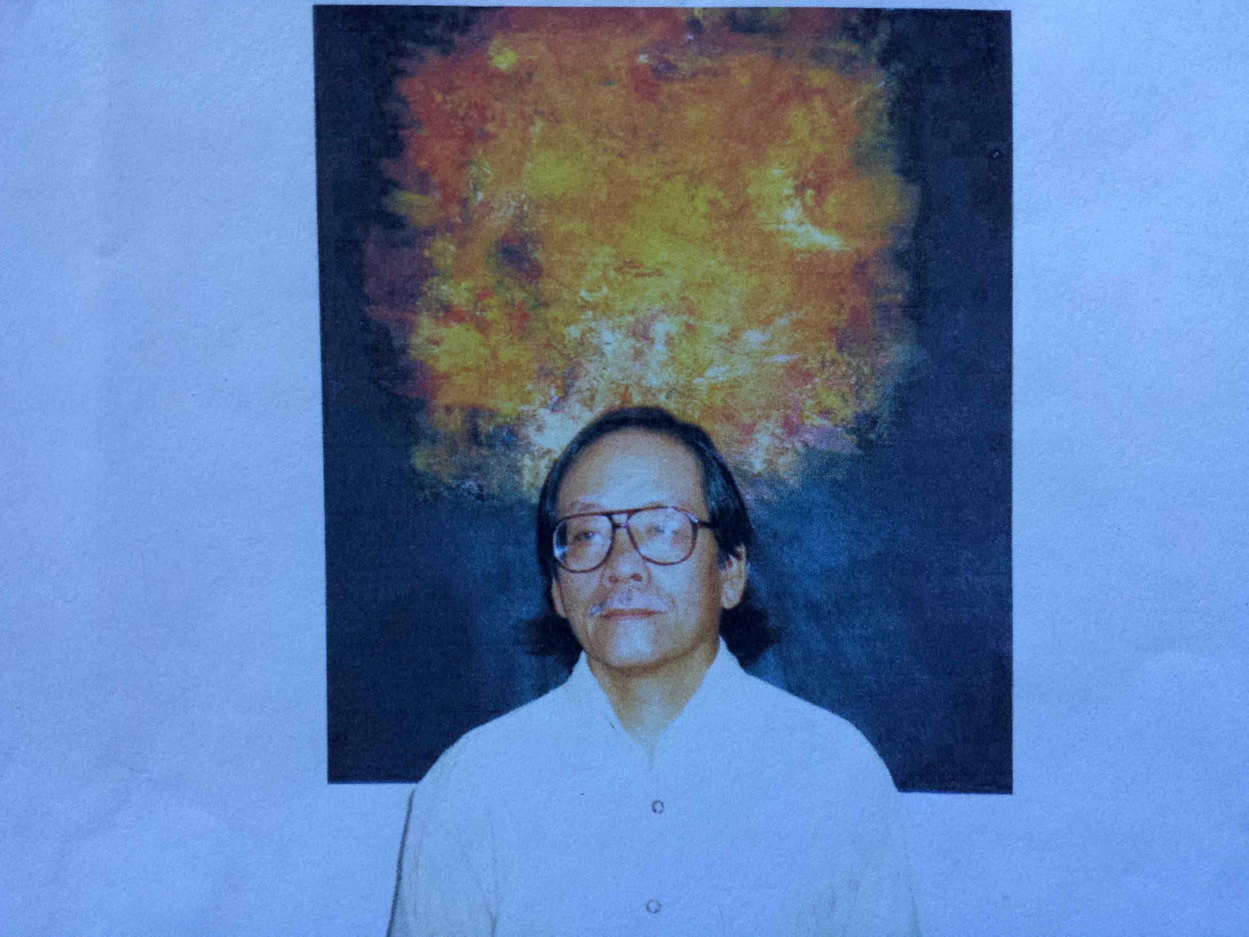 Mai Vo-Dinh in front of one of his favorite paintings.