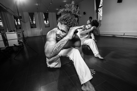 Students train individual movements in formation (such as the Negativa seen above) which are assembled in sequences, and all of which require a tremendous amount of strength, training, agility and flexibility to get right. (Photo by  Ace Murray / Brooklyn Juice Photography .)