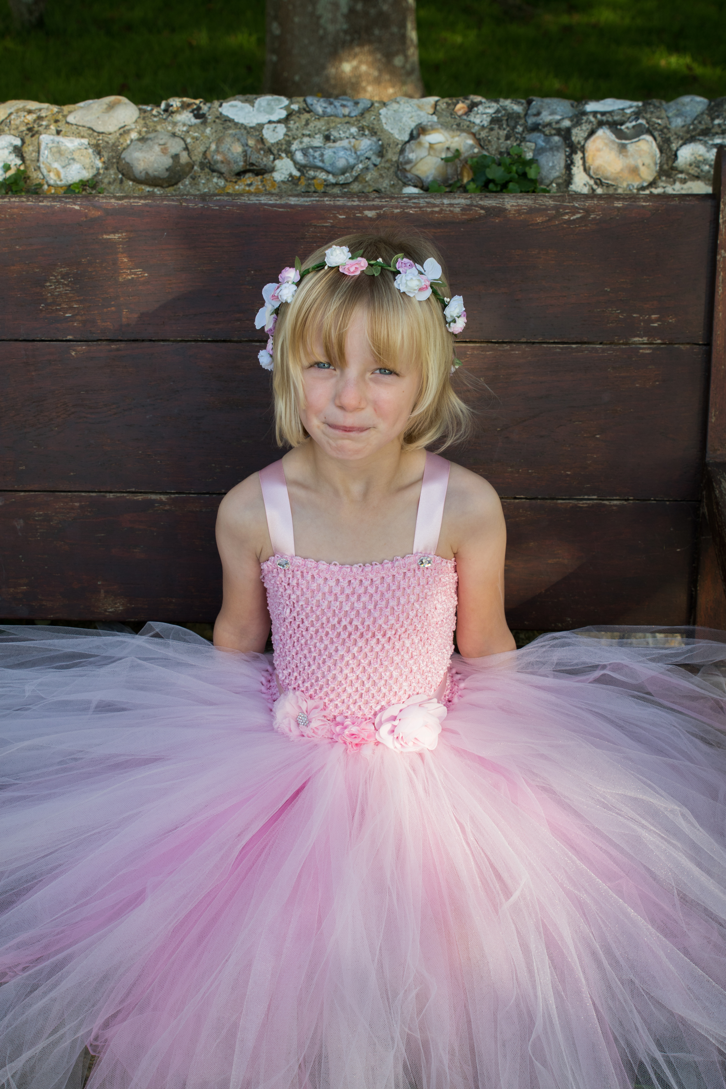 Rose:   Pink crochet top with alternating light pink and dark pink tulle layers. Decorated with various fabric flowers.