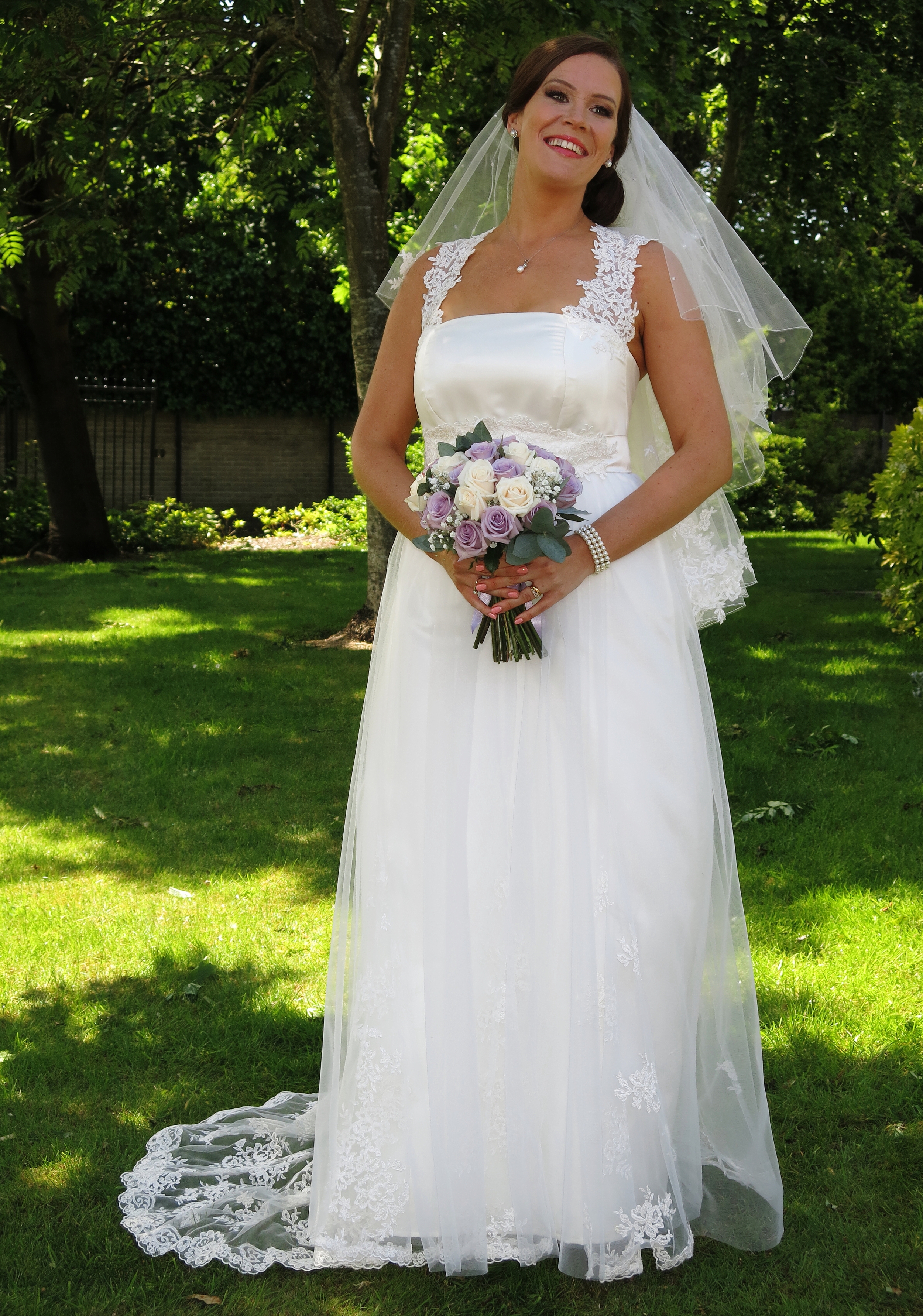 Charlotte :  Duchess satin overlaid with silk tulle, corded lace straps, godets and train.