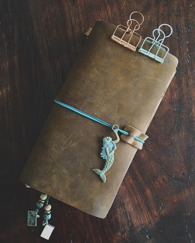 I'm kinda finally getting the hang of this traveler's notebook thing, thanks to @faustine2012! She got me these mermaid charm and made me a bookmark - that, wait for it - is a LETTERLETTER bookmark with the cutest little postcards and all the teal and mint and sparkles! Also she's been on standby for ALL OF THE DUMB QUESTIONS I have about how to do my TN setup! 😍💙💚💖 #midoritravelersnotebook #travelersnotebook #mermaidsandshit