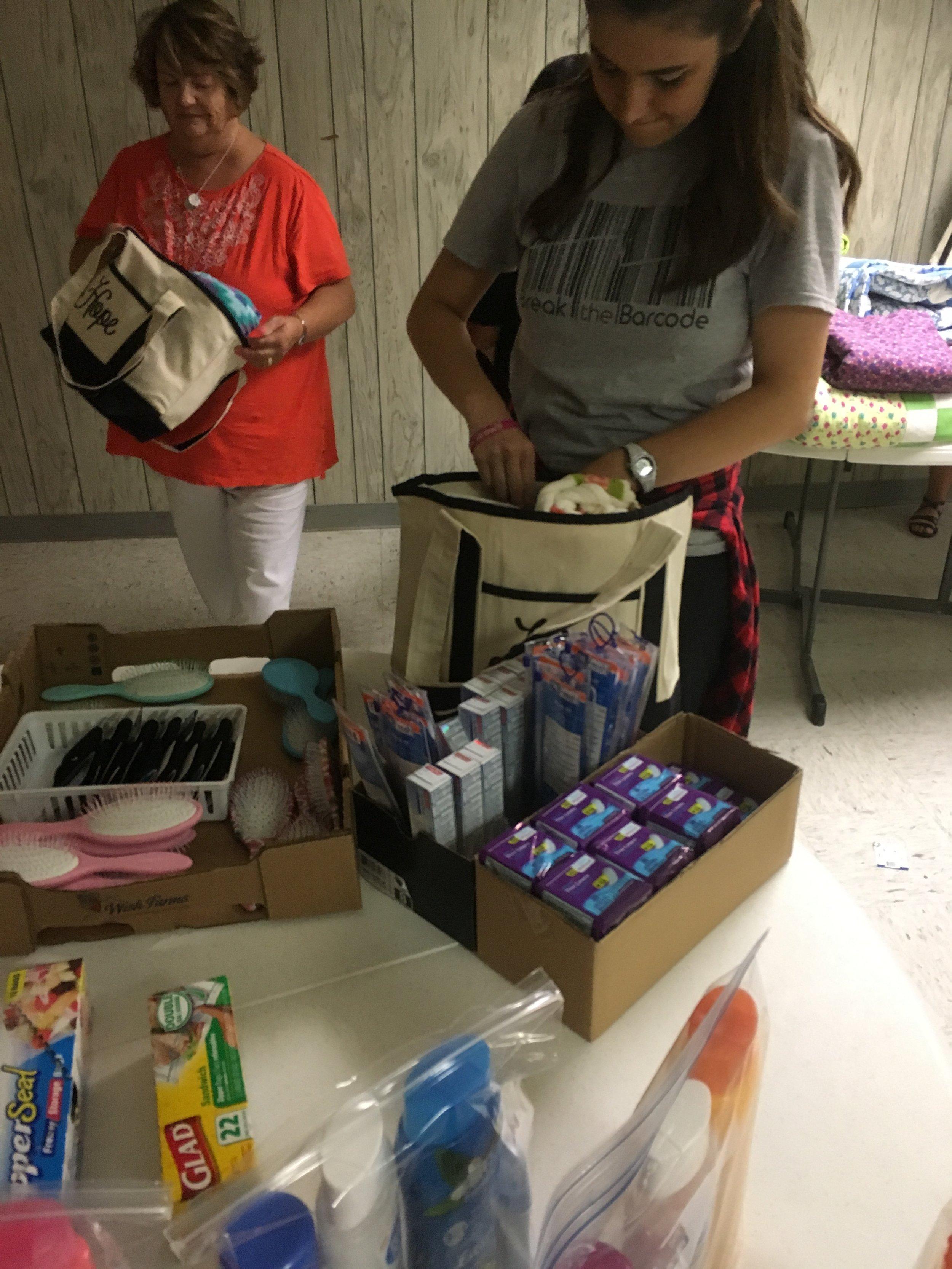 volunteers making hope bags