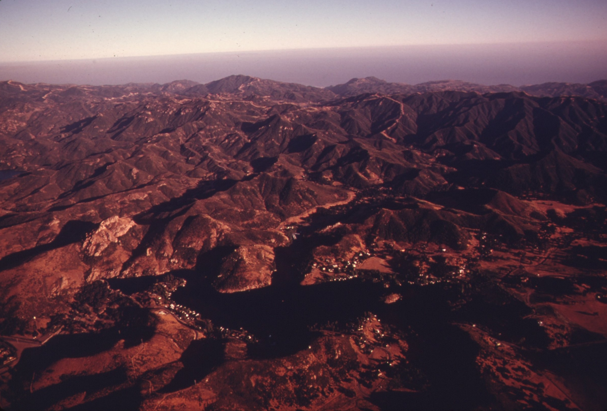 AERIAL_OF_THE_SANTA_MONICA_MOUNTAINS_LOOKING_SOUTH,_NEAR_MALIBU,_CALIFORNIA,_WHICH_IS_LOCATED_ON_THE_NORTHWESTERN..._-_NARA_-_557533.jpg
