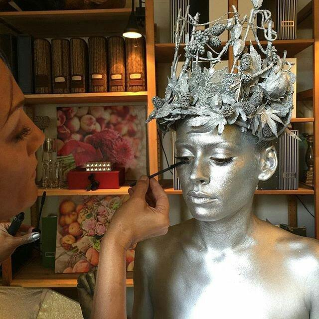 Dawn Stone completes the look on the silver body-painted model wearing only her one-of-a-kind Snow Queen Crown - part of the Dawn Stone Couture Collection.