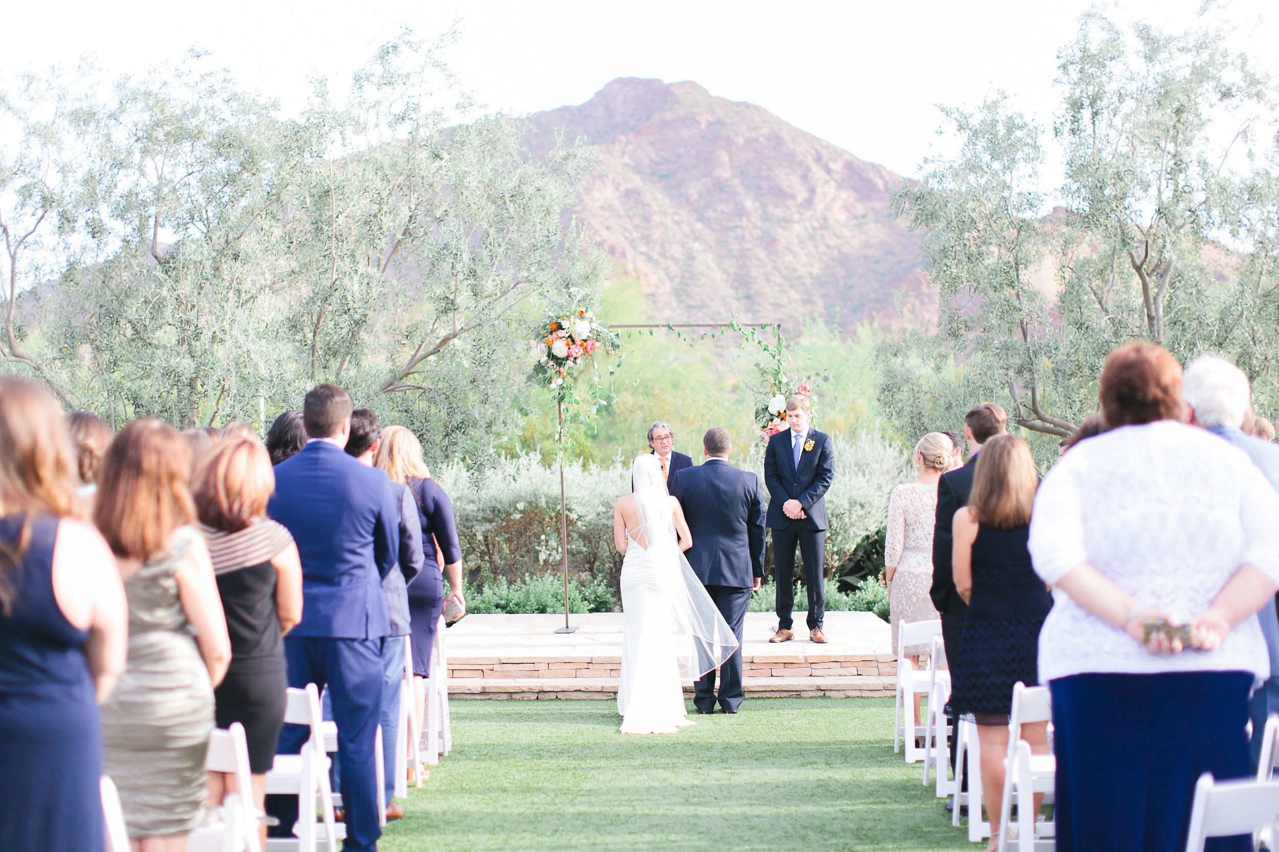 arizona wedding scottsdale el chorro pink peach coral blush planner  ceremony arch
