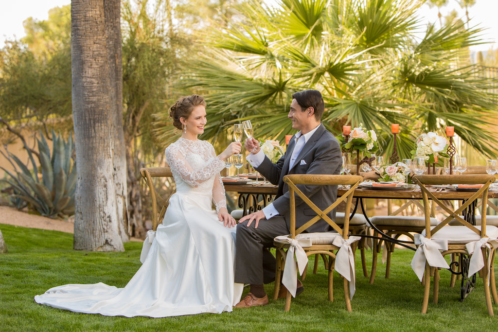 Bride, Groom, Phoenix Scottsdale Arizona Wedding Planner, Bridal gown, lace bridal gown, sleeved bridal gown, Groom attire, grey suit, southwest, ascot, groomsmen attire, Orchids, blush, peach, southwest, elegant, flowers, roses, rustic, western, bridal bouquet