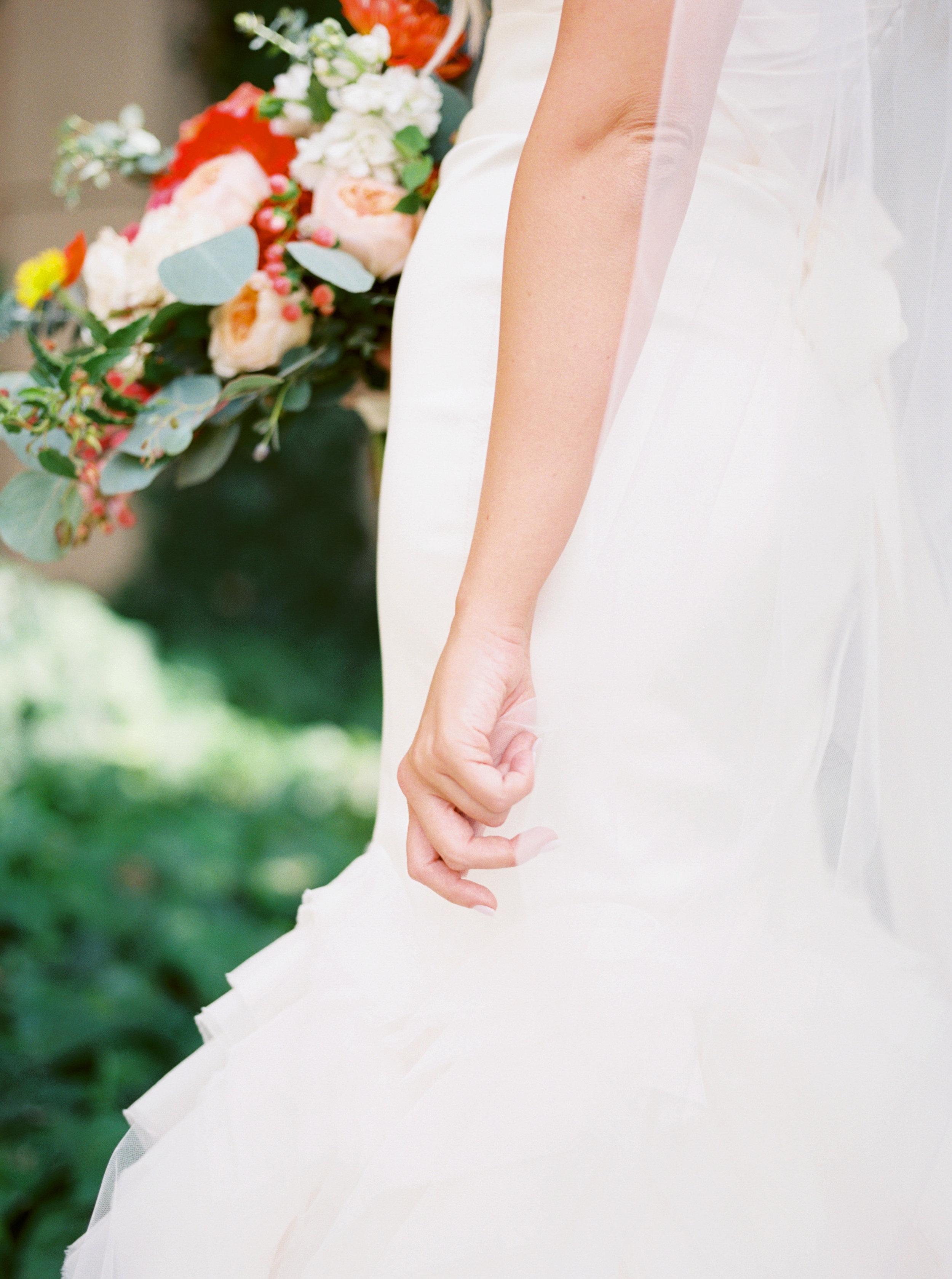 Bride details, bridal veil, wedding dress, Vera Wang wedding dress, engagement ring, bridal bouquet, coral wedding flowers, orange wedding flowers, blush wedding flowers
