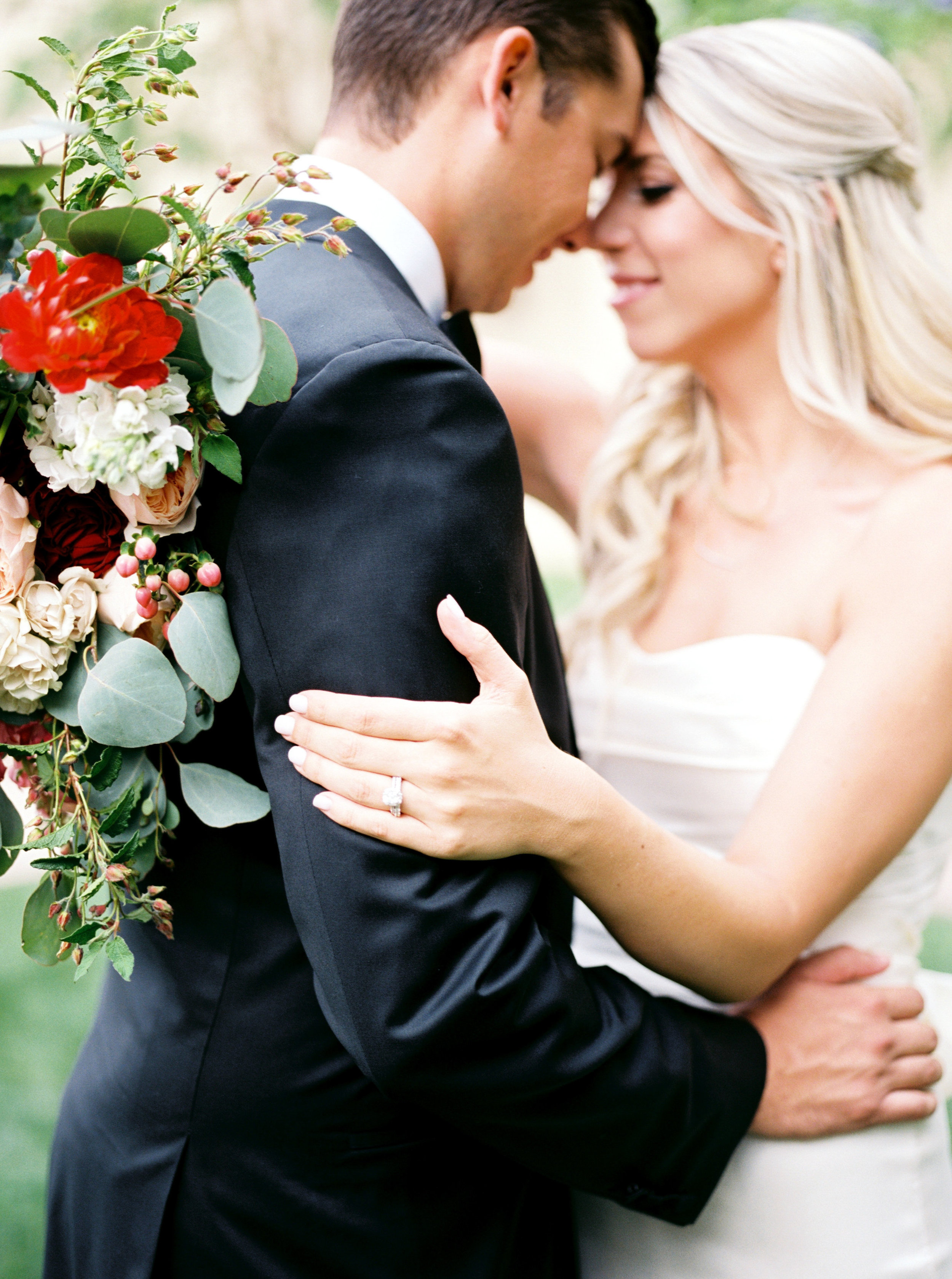 bride and groom photo, bride and groom details, groom tux, bridal gown, bridal bouquet, garden bridal bouquet, orange wedding flowers, red wedding flowers, blush wedding flowers, peach wedding flowers, ivory wedding flowers