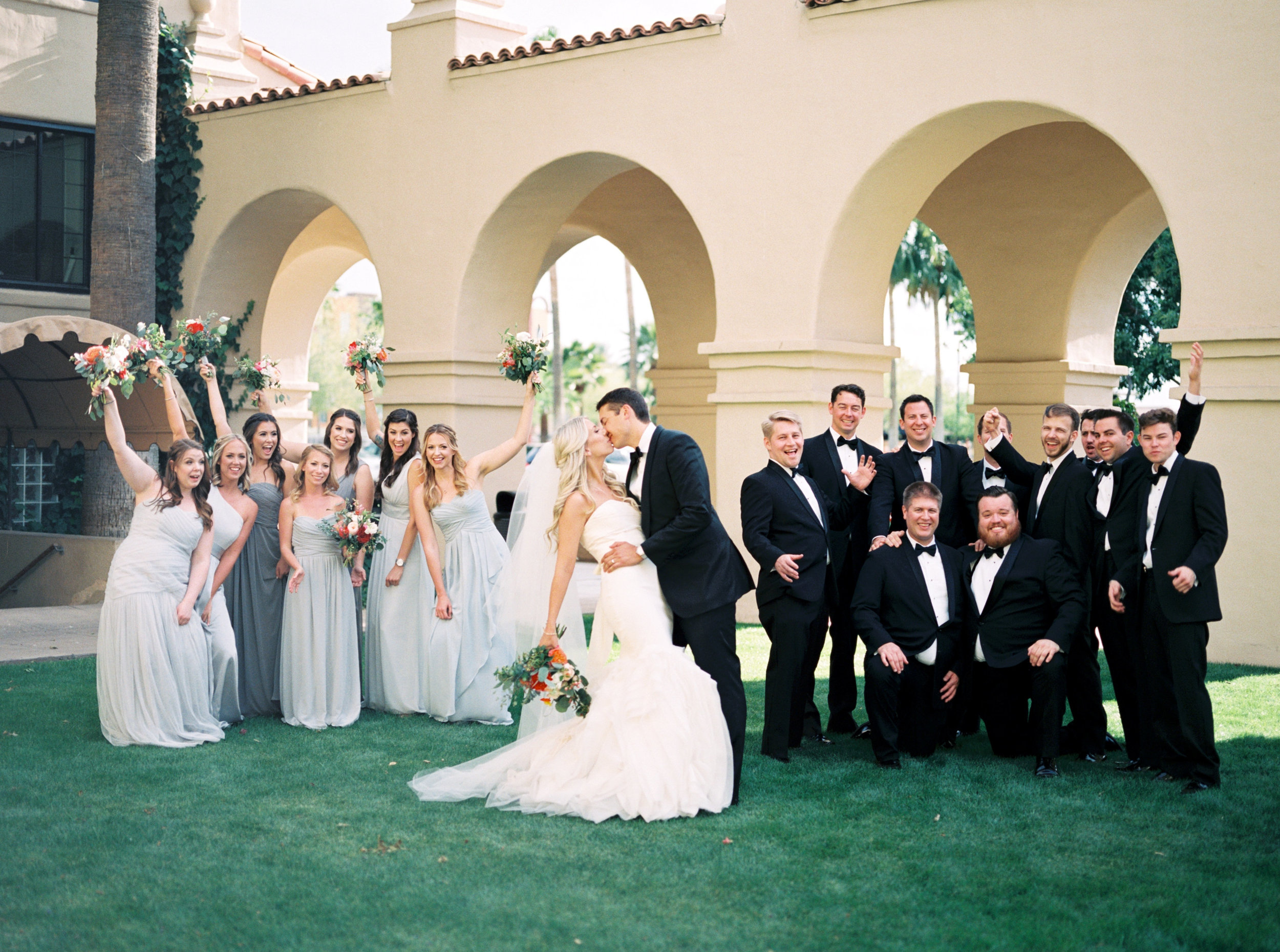 bridal party, bride and groom, bridal bouquet, garden bridal bouquet, gray bridesmaid dresses, bridesmaid bouquets, coral wedding flowers, blush wedding flowers, ivory wedding flowers, orange wedding flowers, groom formal attire, groom tux, groomsmen formal attire.