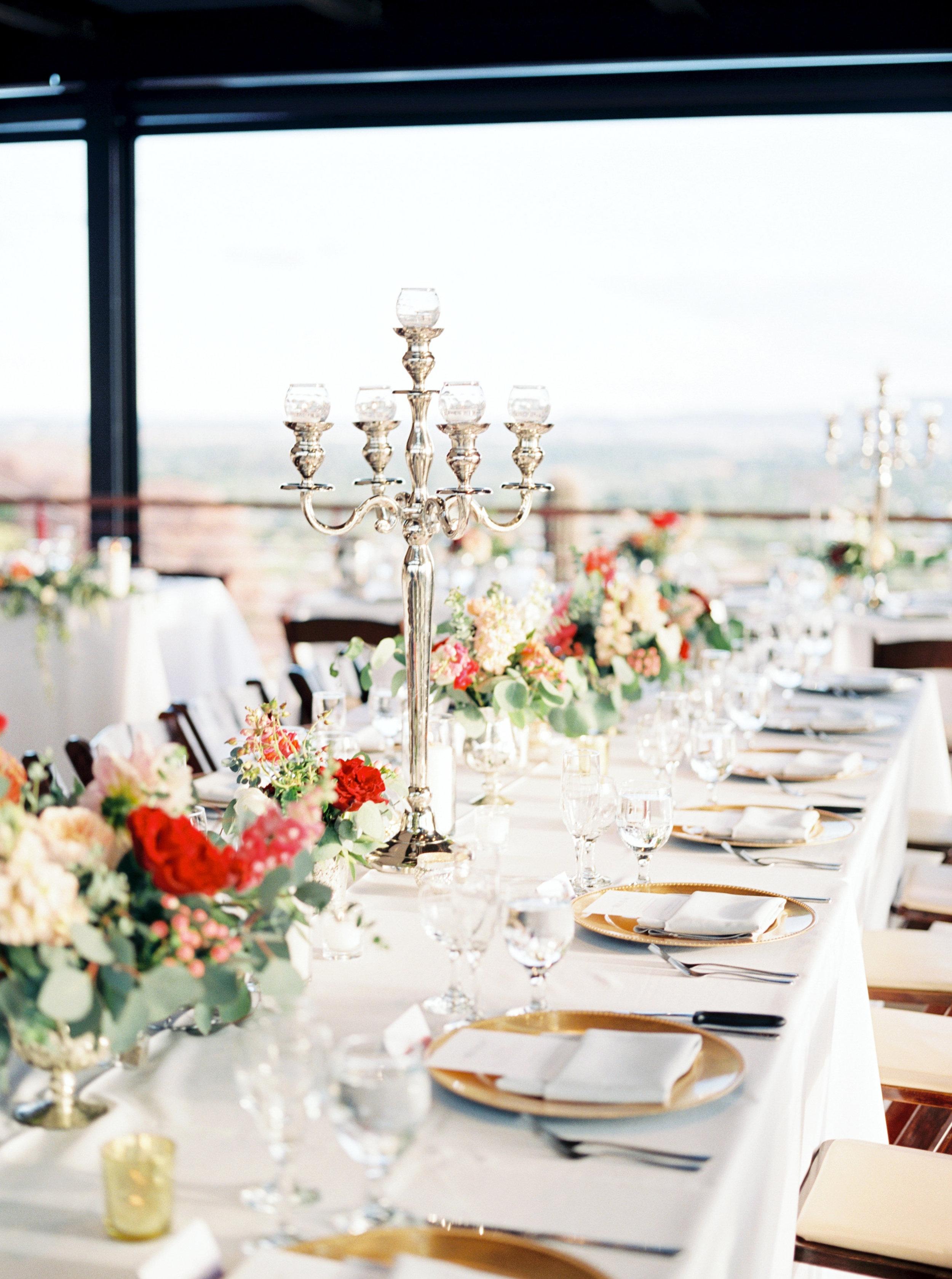wedding centerpiece, white wedding linens, gold chargers, garden wedding flowers, red wedding flowers, peach wedding flowers, ivory wedding flowers, blush wedding flowers, silver candleabras
