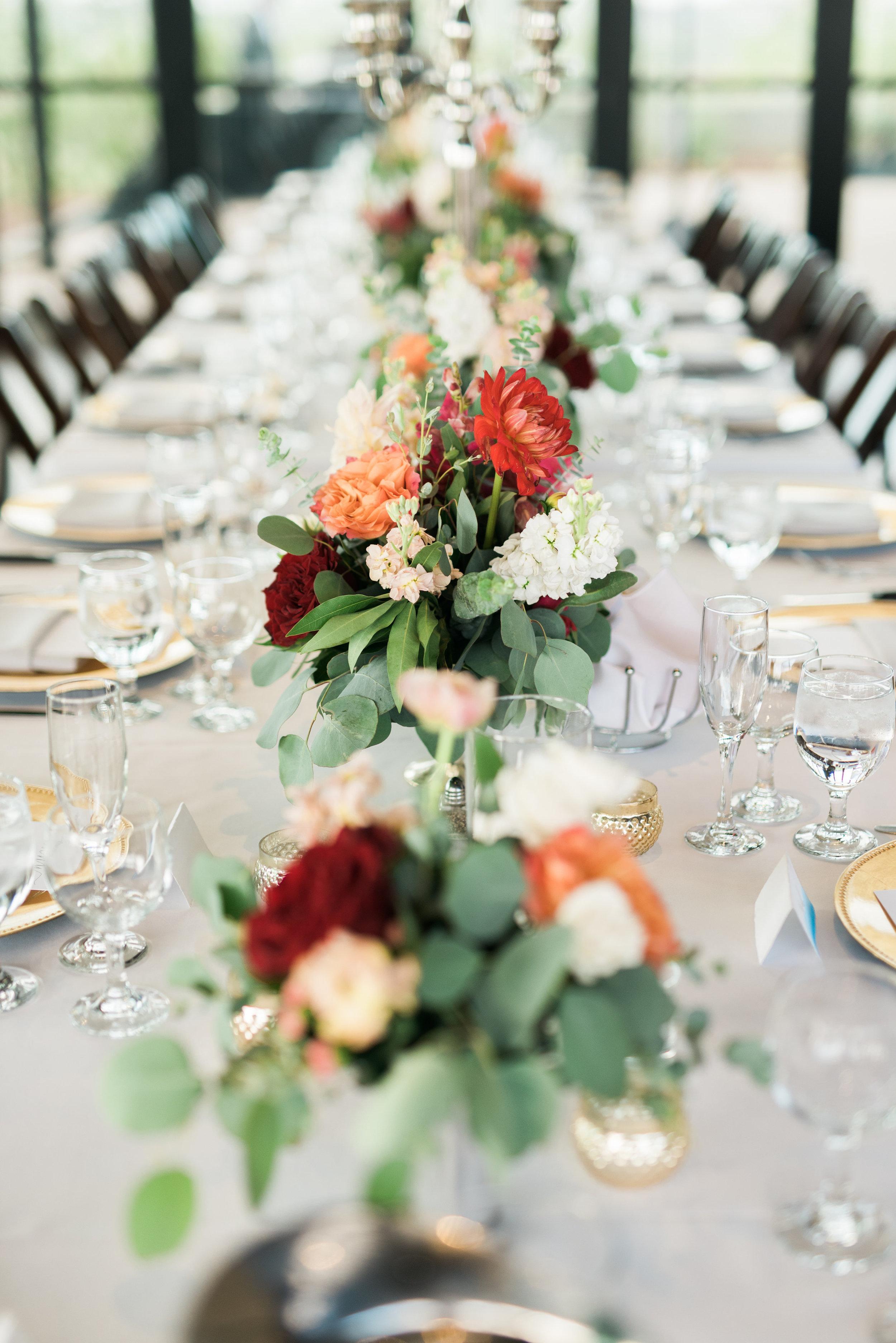 wedding centerpiece, white wedding linens, gold chargers, garden wedding flowers, red wedding flowers, peach wedding flowers, ivory wedding flowers, blush wedding flowers, silver candleabras, mercury glass