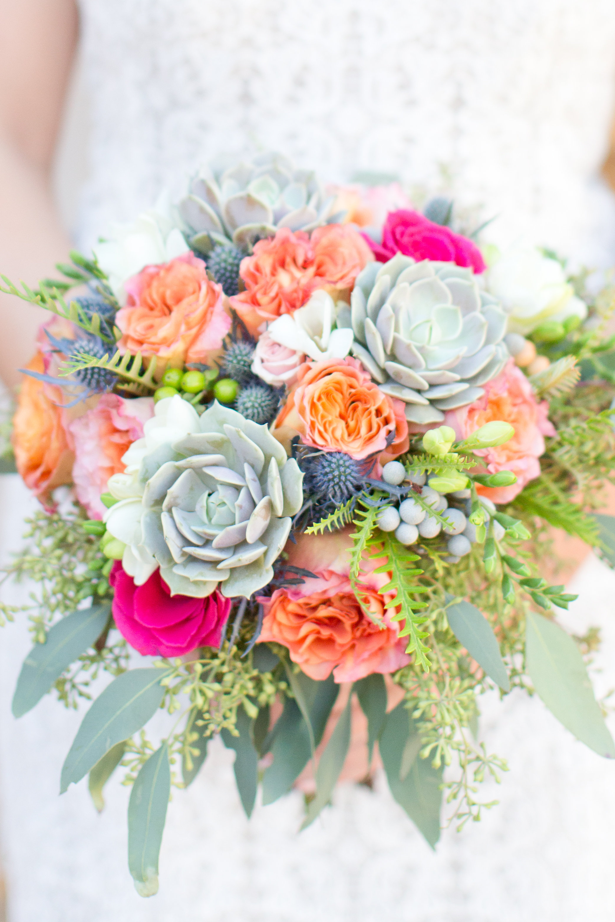 Phoenix-Scottsdale-Arizona-Wedding-Planner-Wedding-Venue-Destination-Wedding-Planner, Omni Montelucia weddings, sunset weddings, Arizona Sunset weddings, wedding details, bridal bouquet, succulent bouquets, orange pink blue green flowers