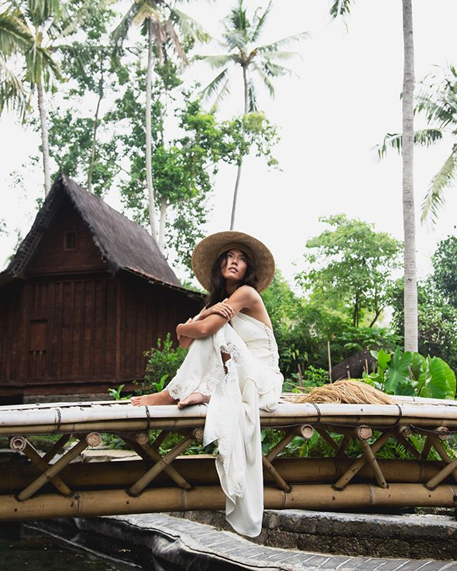 bali is covered in rice fields. so i imagined a bride who is proud to be the farmer's daughter, carrying a rice bouquet as a symbol of her commitment to the land, to her origins, and also as a classic symbol of fertility - not only of her body but also of her spirit.  #bali #bride #weddingdress #rice #love