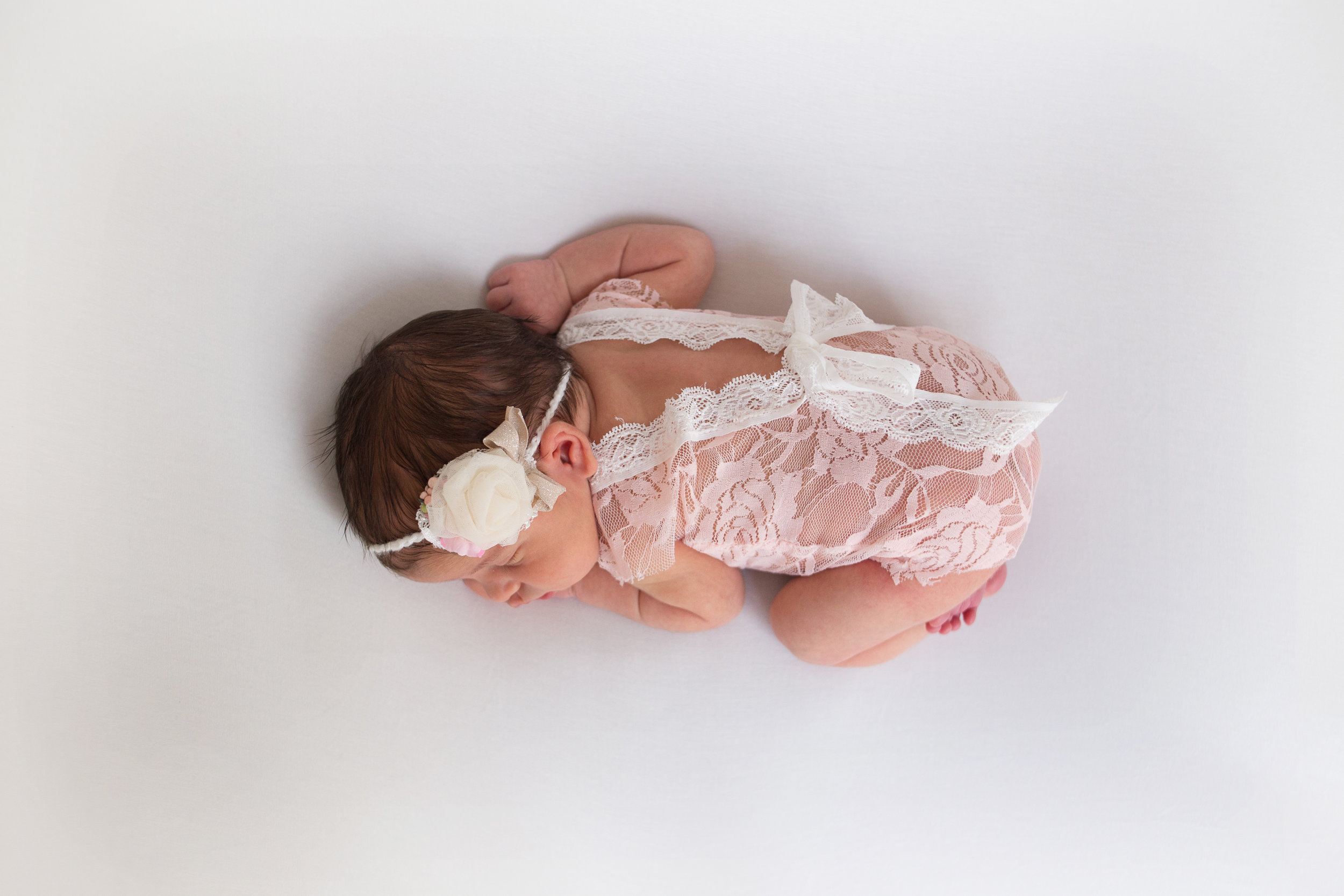 orange county newborn sleeping through their photography session