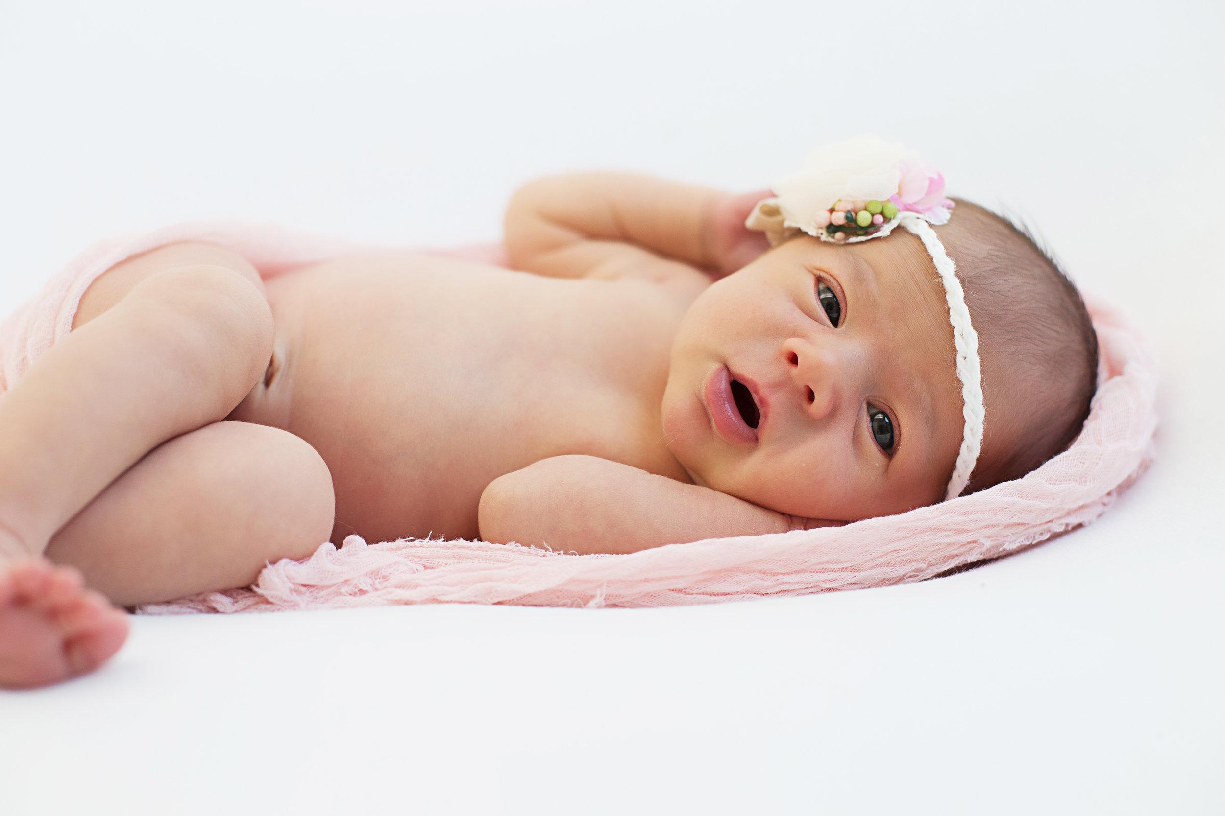 orange county newborn awake unposed through their photography session