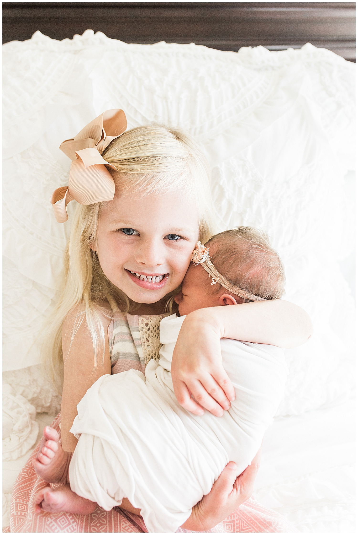 orange county newborn sisters at their photography session