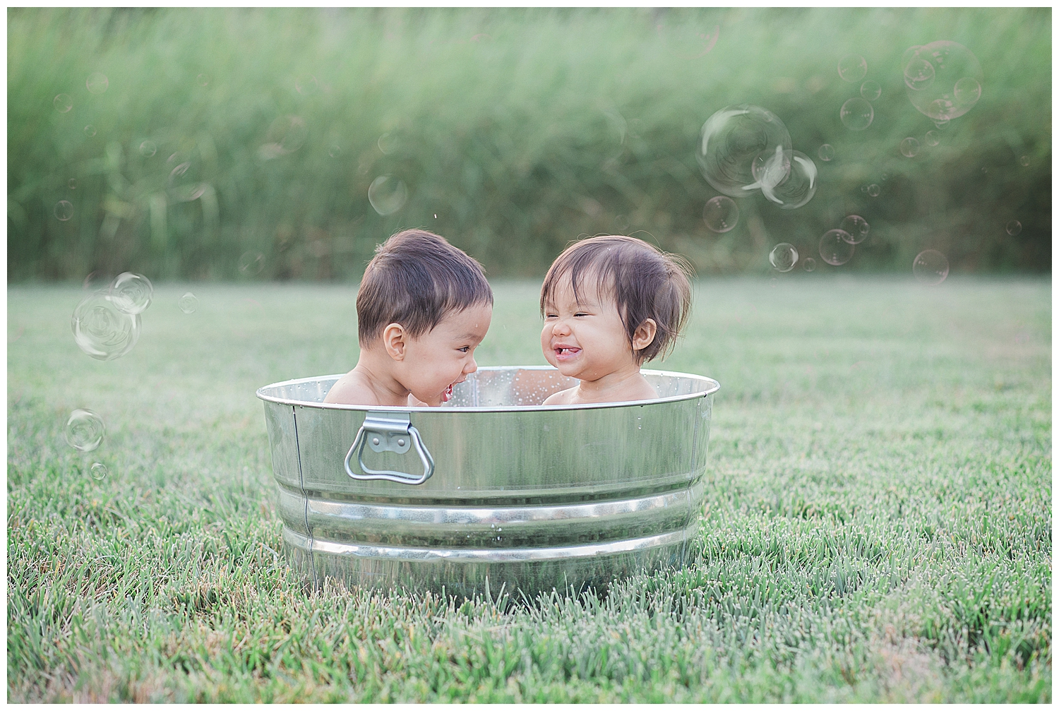 orange county baby playing in the water outside during their photography session