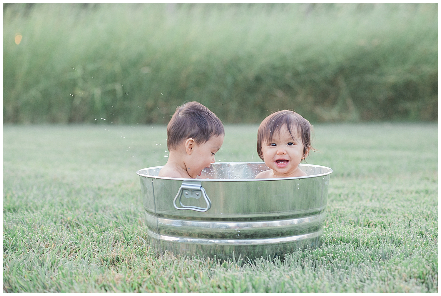 orange county baby playing in the water during their photography session