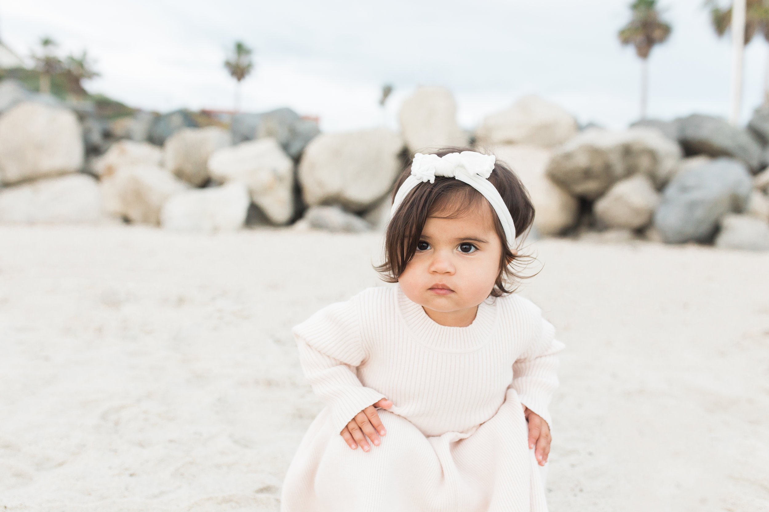 orange county baby sitting  during their outside beach photography session