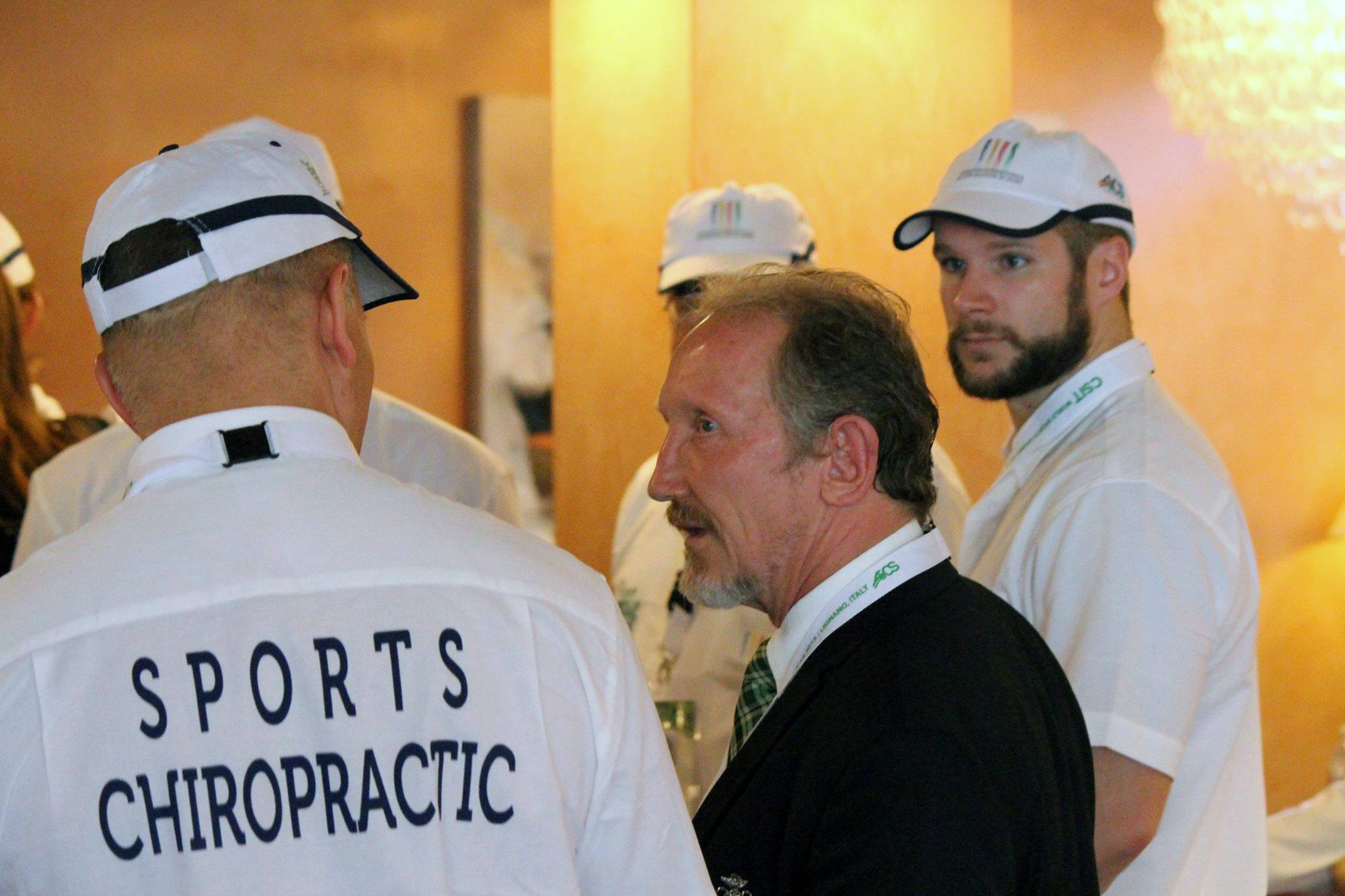 Dr. Ray speaking to his team of sports chiropractors