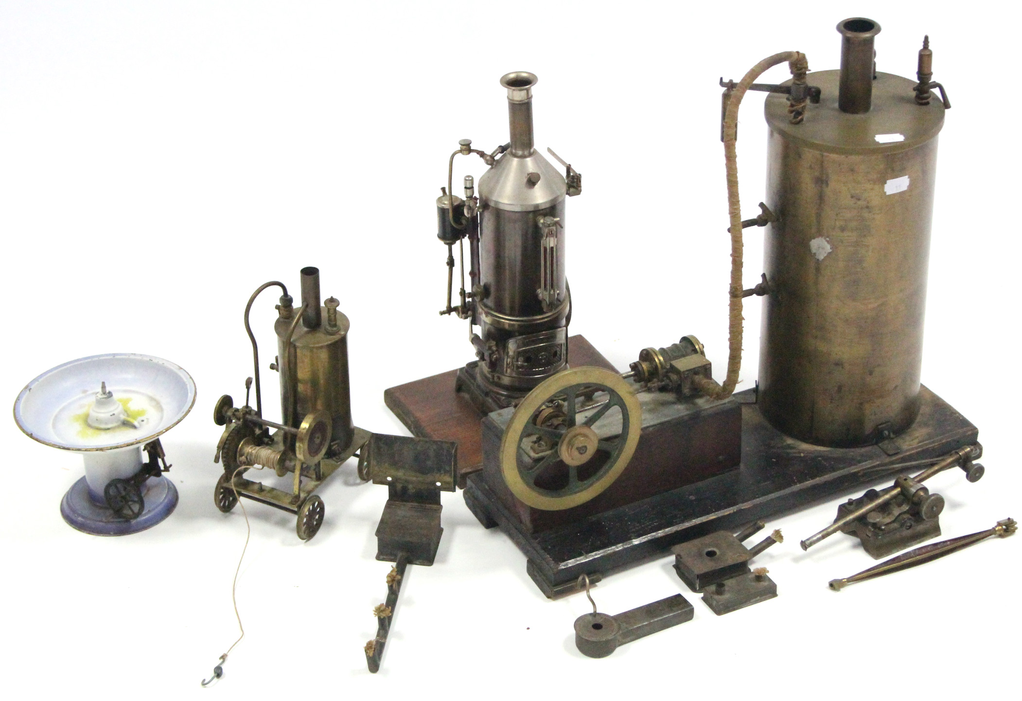 """Sold For £1,300. A brass scratch-built stationary steam engine, 16¾"""" high; & two similar smaller ditto."""