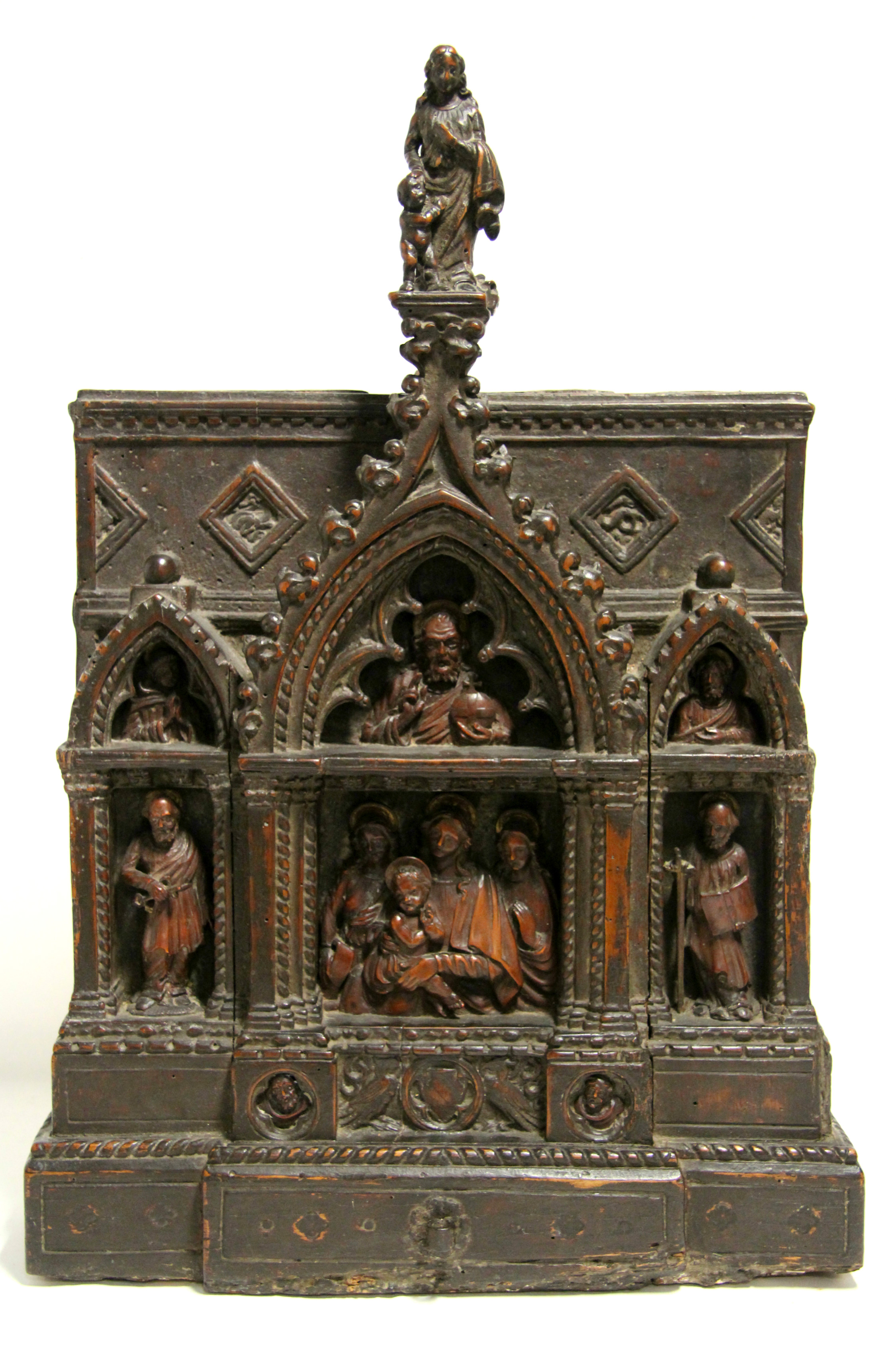 Sold For £7,700  An early carved walnut alter piece