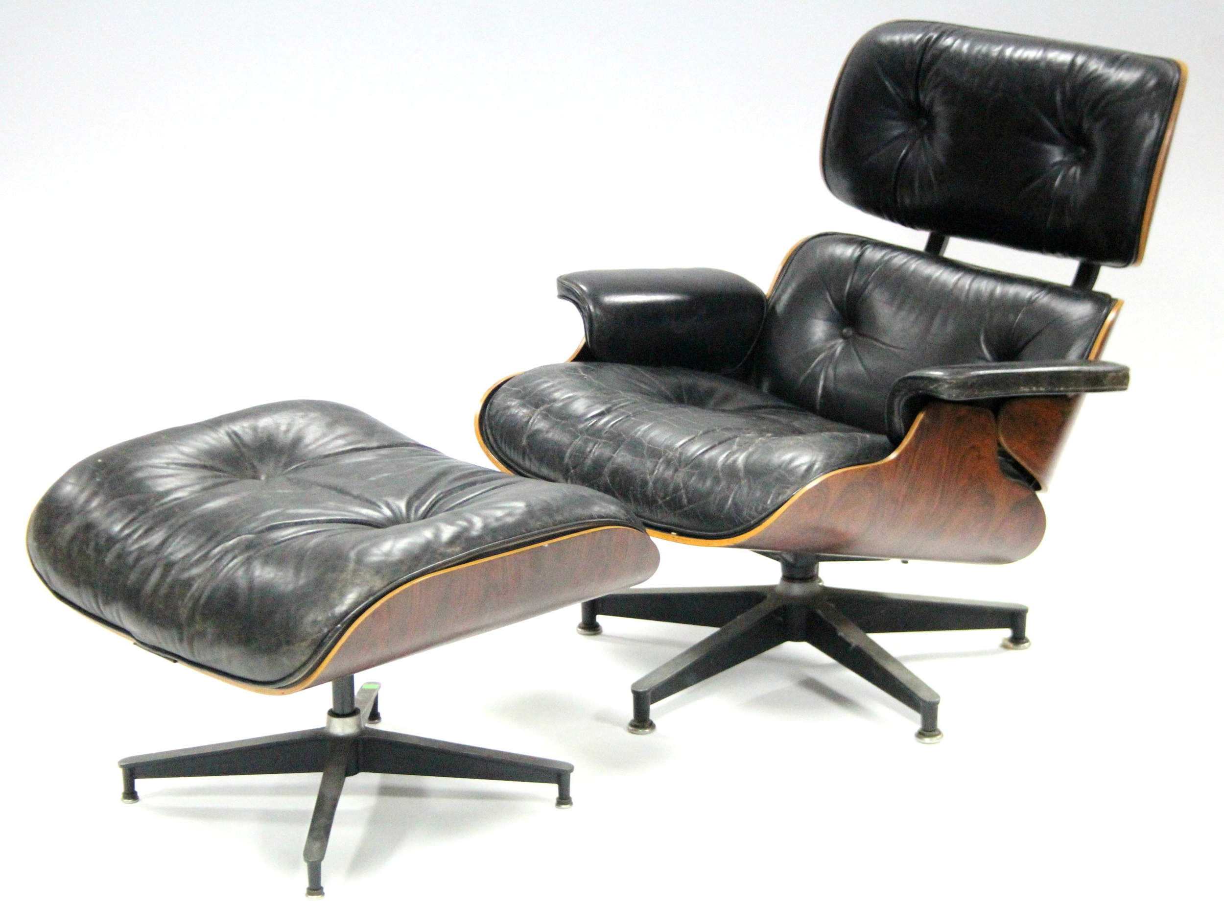 Sold For £3,500  Charles & Ray Eames '670' lounge chair & ottoman.