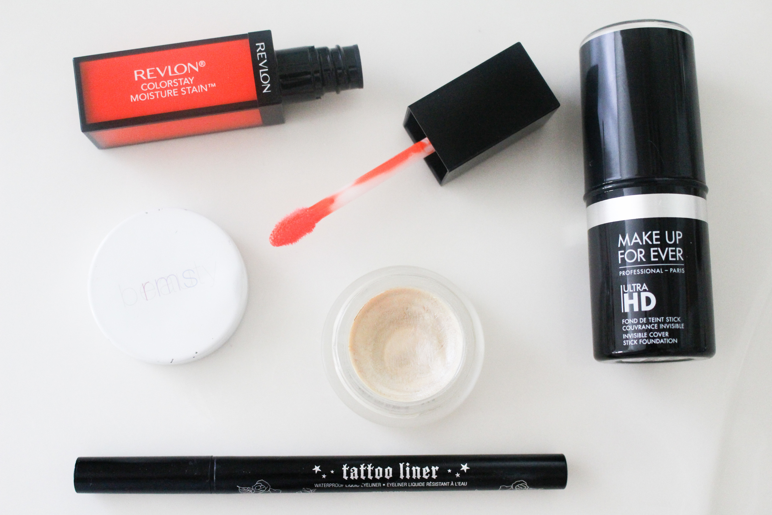 BRIGHT COMPLEXION, GRAPHIC LINER, AND AN ORANGE LIP
