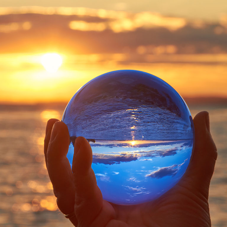 Photo of Glass Ball showing the future and how Self Care will help you to enjoy greater fulfillment on your Journey.