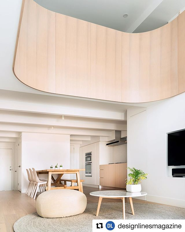 """What a pleasure to be part of this sophisticated and challenging build, we built all the millwork in this incredible space including the curves and kitchen. Custom stained and shaded white oak with 10 sheen post cat.  #Repost @designlinesmagazine (@get_repost) ・・・ For an east end loft, @studioac_architecture crafted a striking 7.8-metre-long curved white oak balcony that embraces the majestic double-height living room. """"Curving it was really about emphasizing the space, and creating something soft and iconic,"""" says co-founder Andrew Hill. Read about this sunshine-filled home through the link in our profile 🌀☀️ Photo by Jeremie Warshafsky"""