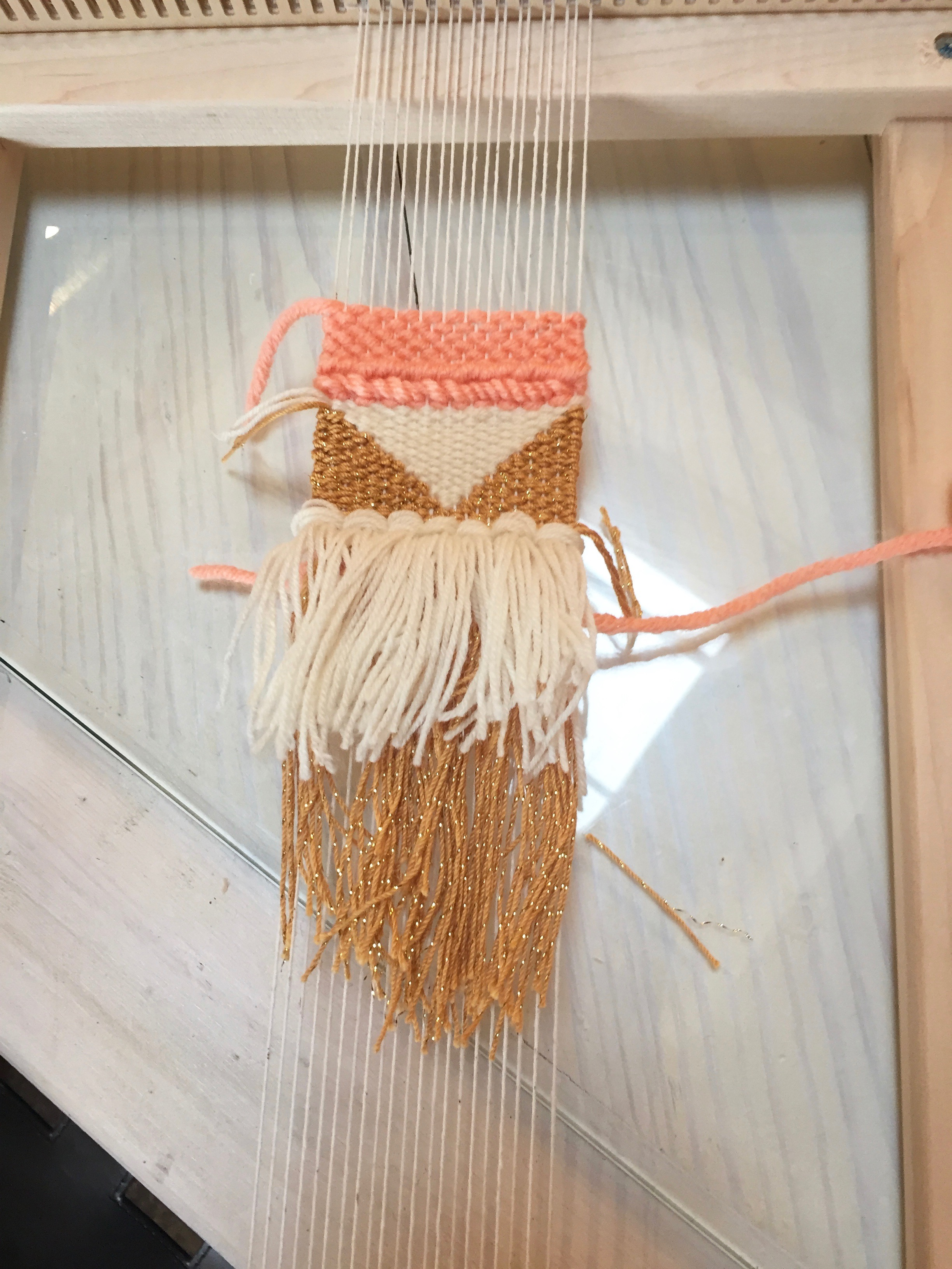 My finished weaving still on the loom, pre weaving in the ends.
