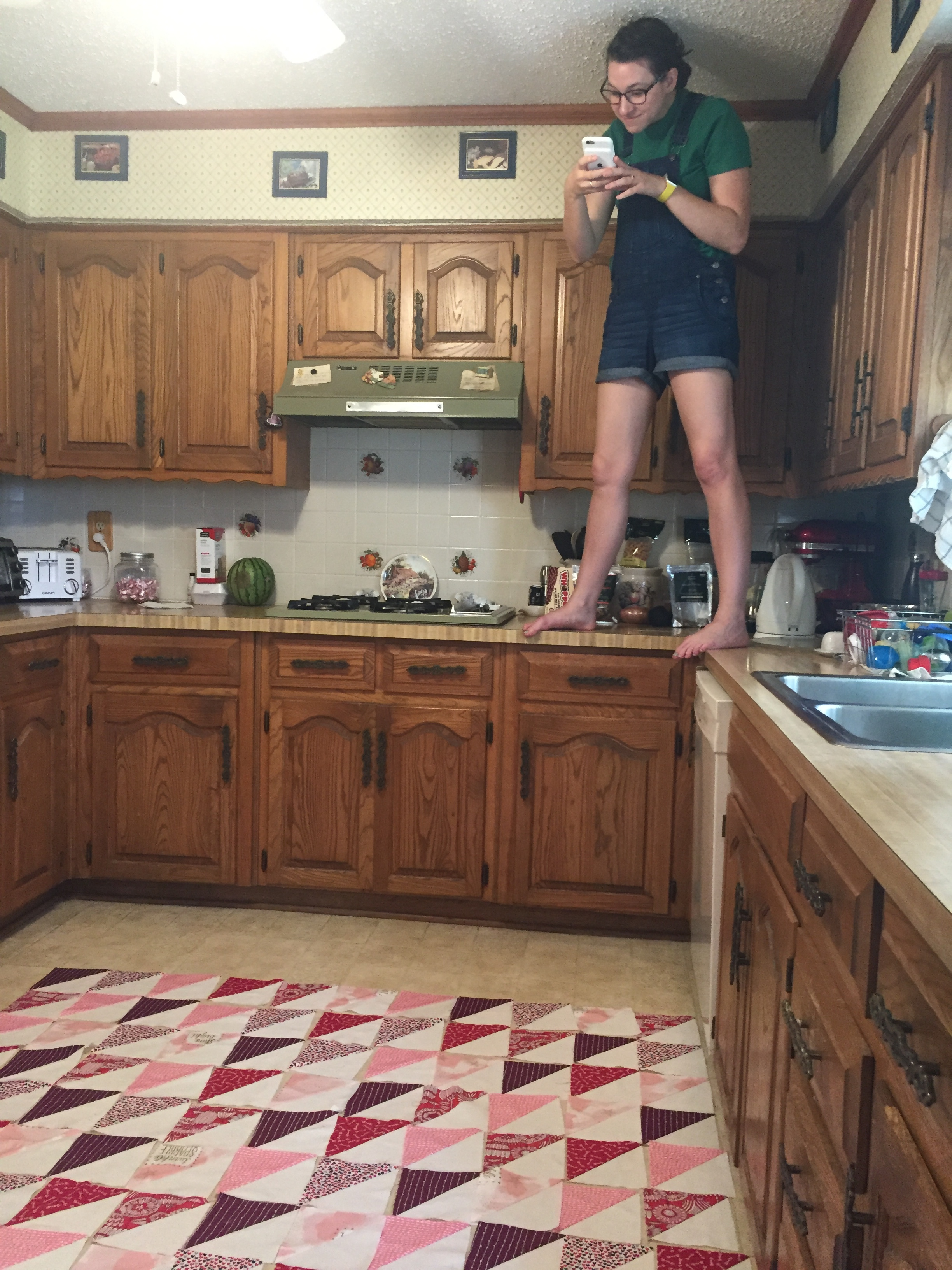 Every quilter has taken pics from above to see how the colors look from a distance. It's just a part of the quilting process. My sister had to stand on the counter to properly look at hers! #beentheredonethat
