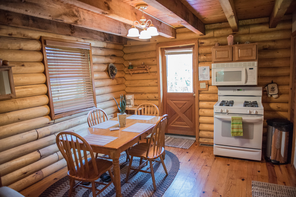 Interior dining area of our log cabin in Indiana.