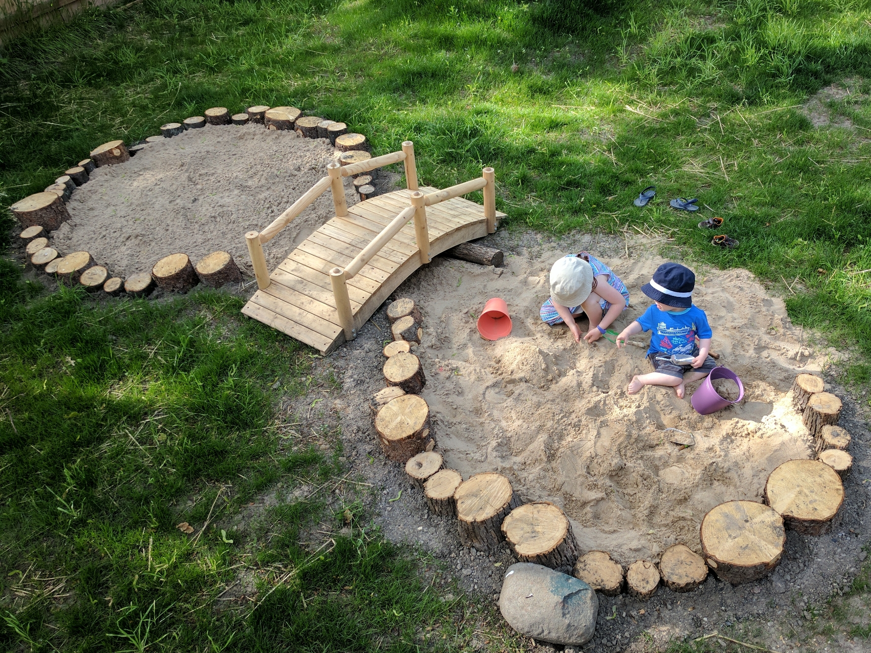 Breaking in the new sand area in the Nestling House yard.